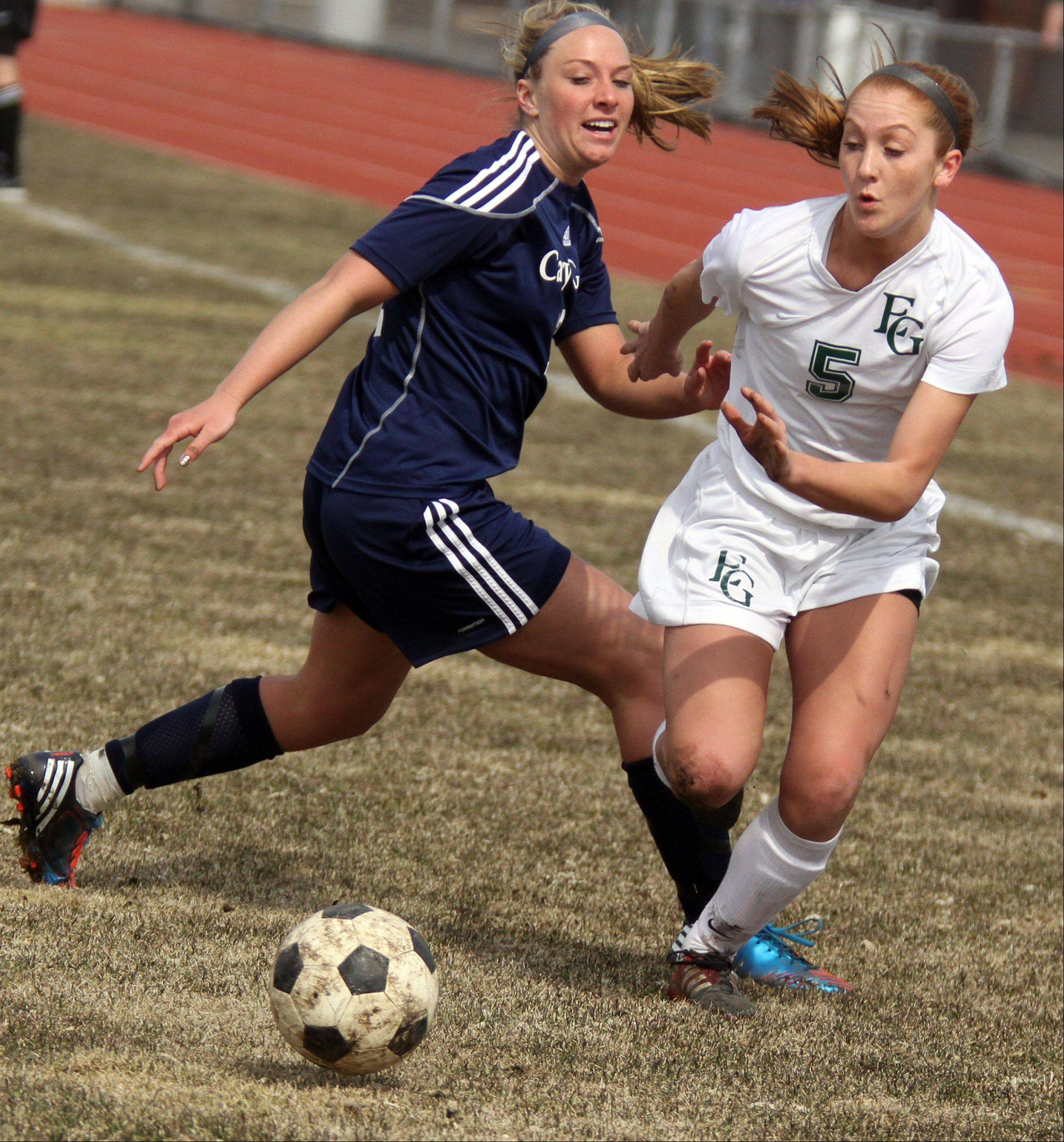 Elk Grove's Kelly Naughton and Cary-Grove defender Brittany Loehner fight for position in Elk Grove on Saturday.
