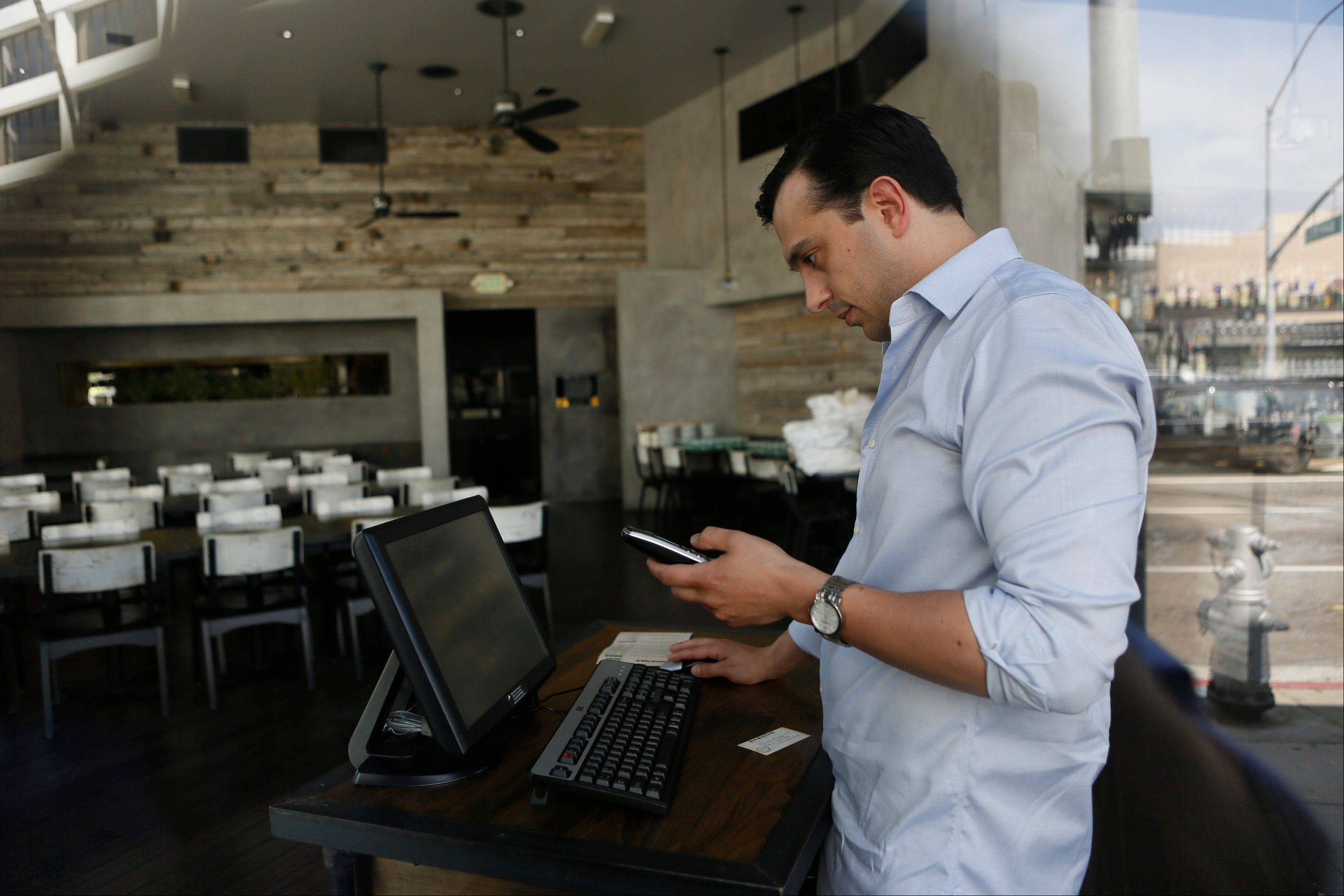 A Red Medicine employee stands at a computer terminal at the Beverly Hills, Calif. restaurant. Noah Ellis, co-owner of Red Medicine, recently took to Twitter to publicly call out those who skipped out on their reservations on a recent busy Saturday.