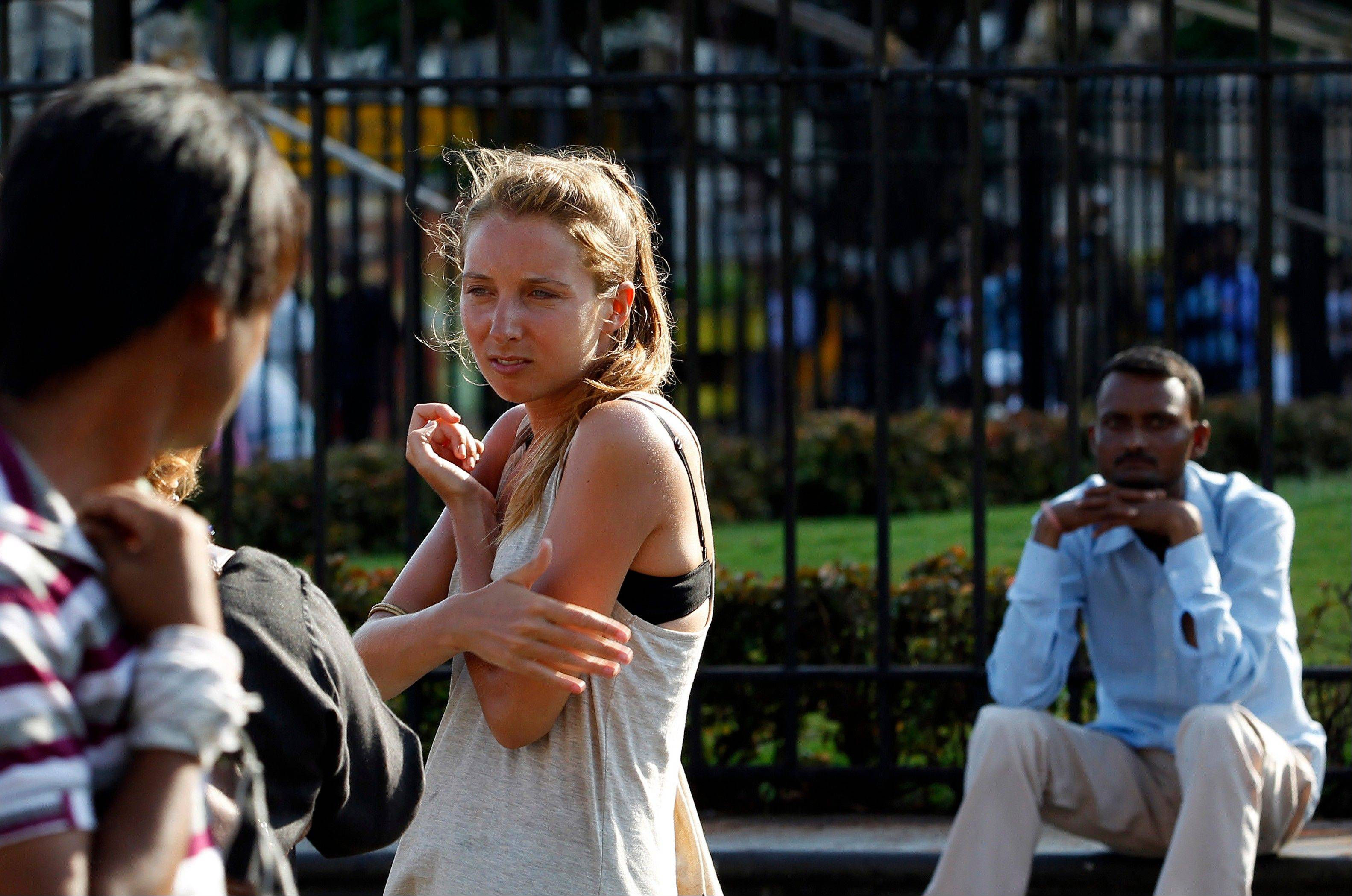 German tourist Carolina De Paola, 22, walks near the landmark Gateway of India in Mumbai, India. A fatal gang rape in New Delhi didn�t deter Germans De Paolo and Canan Wahner from traveling to India for a six-week tour. On a train, a man grabbed De Paolo�s breasts from behind but she never reported the crime, deciding there would be no point. Violence against women, and the huge publicity generated by recent attacks here, is threatening India�s $17.7 billion tourism industry with a new study showing tourism has plunged.