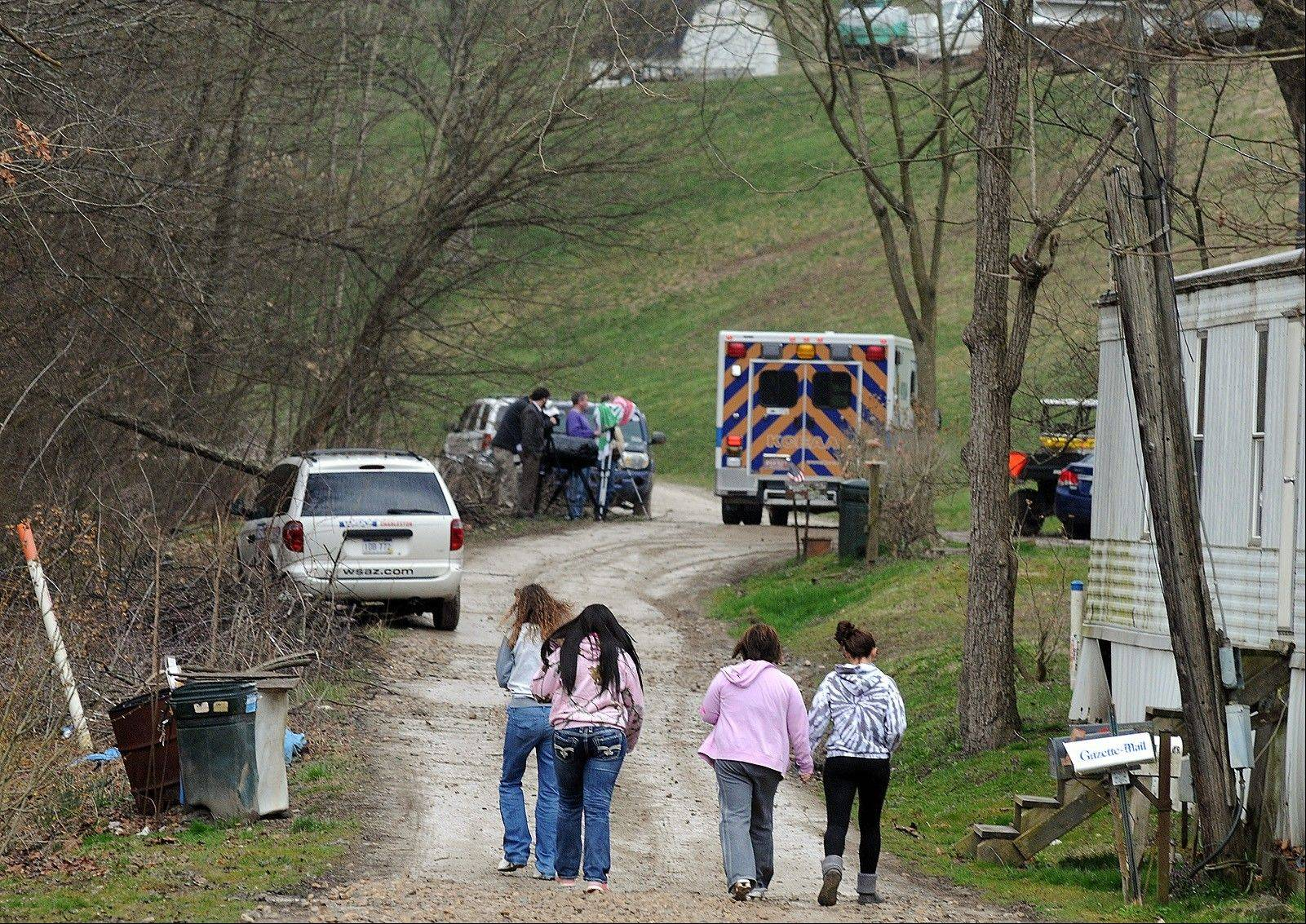 Friends and neighbors walk up and down the gravel road leading to Shain Gandee�s home in Sissonville, W.Va. Gandee, star of the MTV show �Buckwild�; his uncle, David Gandee; and Donald Robert Myers were found dead in the family�s Ford Bronco Monday morning. Shain Gandee died doing what made him famous: careening through huge mudholes in his SUV, taking chances most others won�t, living free and reckless in front of reality-show TV cameras.