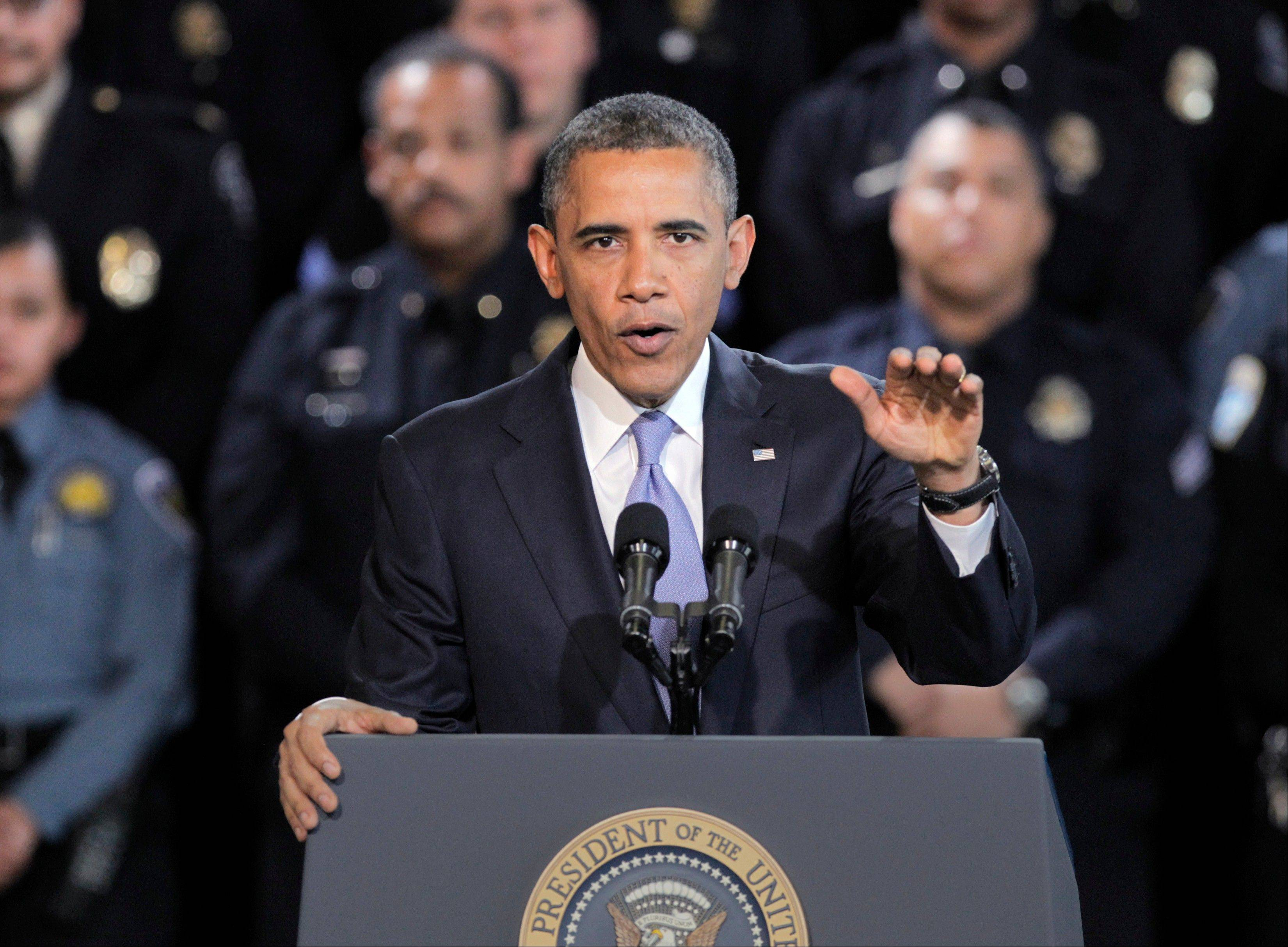 President Barack Obama speaks about gun control at the Denver Police Academy on Wednesday. He also met with local law enforcement officials and community leaders to discuss the state�s new measures to reduce gun violence.