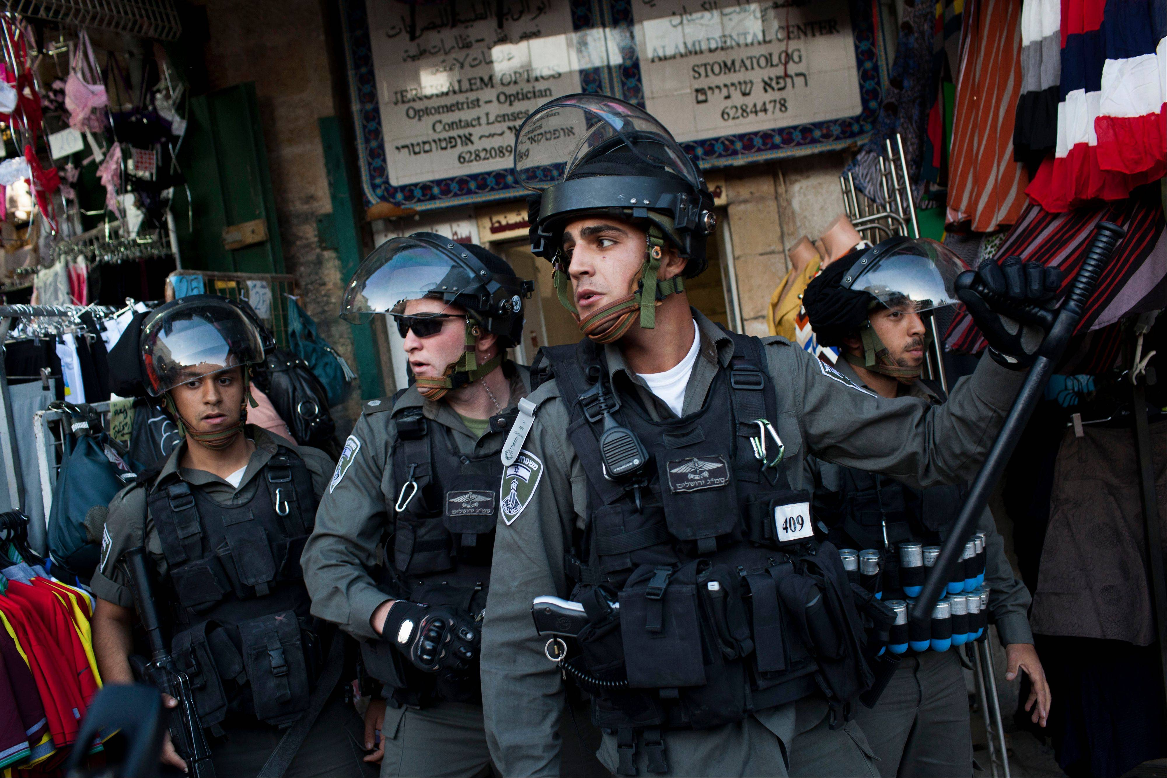 Israeli Border Police take position during clashes in Jerusalem�s Old City, Tuesday, April 2, 2013. Clashes erupted during a protest in support of Maysara Abu Hamdiyeh, 64, who was serving a life sentence for his role in a foiled attempt to bomb a busy cafe in Jerusalem in 2002, and died Tuesday of cancer in an Israeli jail. Tensions are high in Israeli lockups where thousands of Palestinian security prisoners are being held.