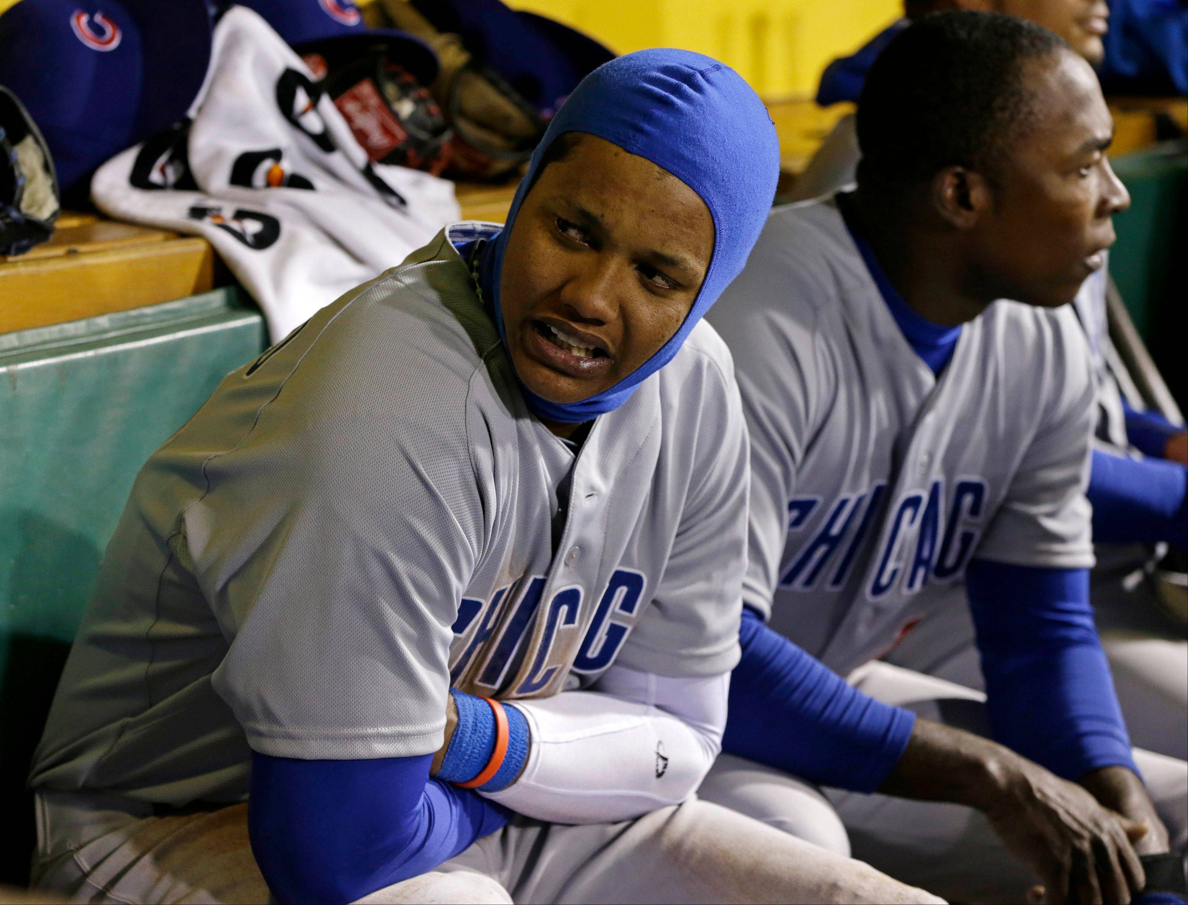 Starlin Castro, left, and Chicago Cubs left fielder Alfonso Soriano sit on the bench in the ninth inning during a baseball game against the Pittsburgh Pirates in Pittsburgh, Wednesday, April 3, 2013. The Pirates win 3-0.