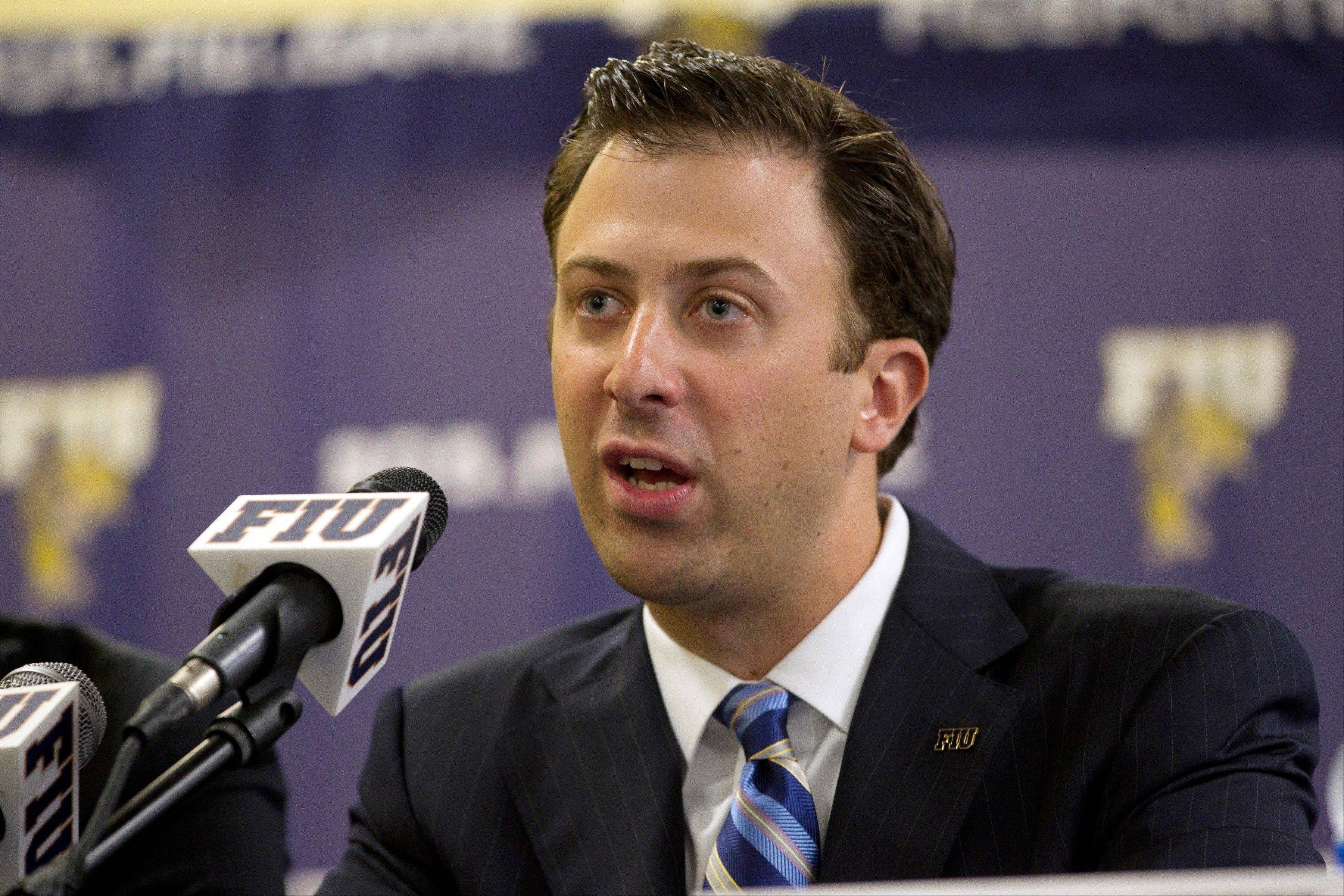 FILE - In this April 16, 2012 file photo, Richard Pitino talks to the media during a press conference in Miami. Minnesota is in advanced discussions with Richard Pitino, the son of Louisville coach Rick Pitino, to take over for Tubby Smith. Two people with knowledge of the discussions say Pitino engaged in negotiations with Minnesota officials on Wednesday, April 3, 2013. The people requested anonymity because the deal has not been formally completed. In his lone season at Florida International, Pitino led the Panthers to an 18-14 record, the school's first winning season in 13 years. (AP Photo/J Pat Carter, File)