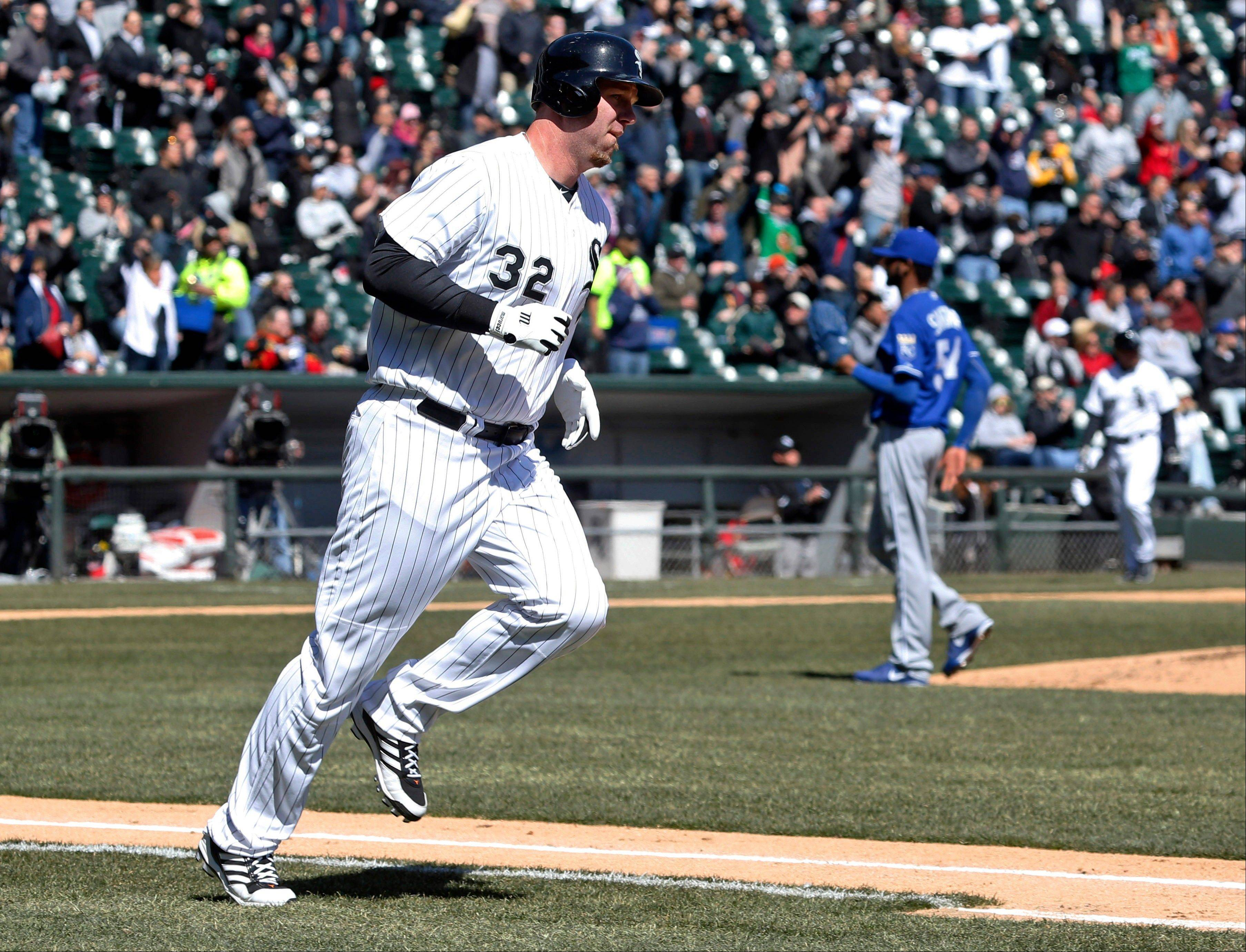 Chicago White Sox designated hitter Adam Dunn rounds the bases after hitting a home run off Kansas City Royals starting pitcher Ervin Santana during the second inning of a baseball game Wednesday, April 3, 2013, in Chicago. (AP Photo/Charles Rex Arbogast)