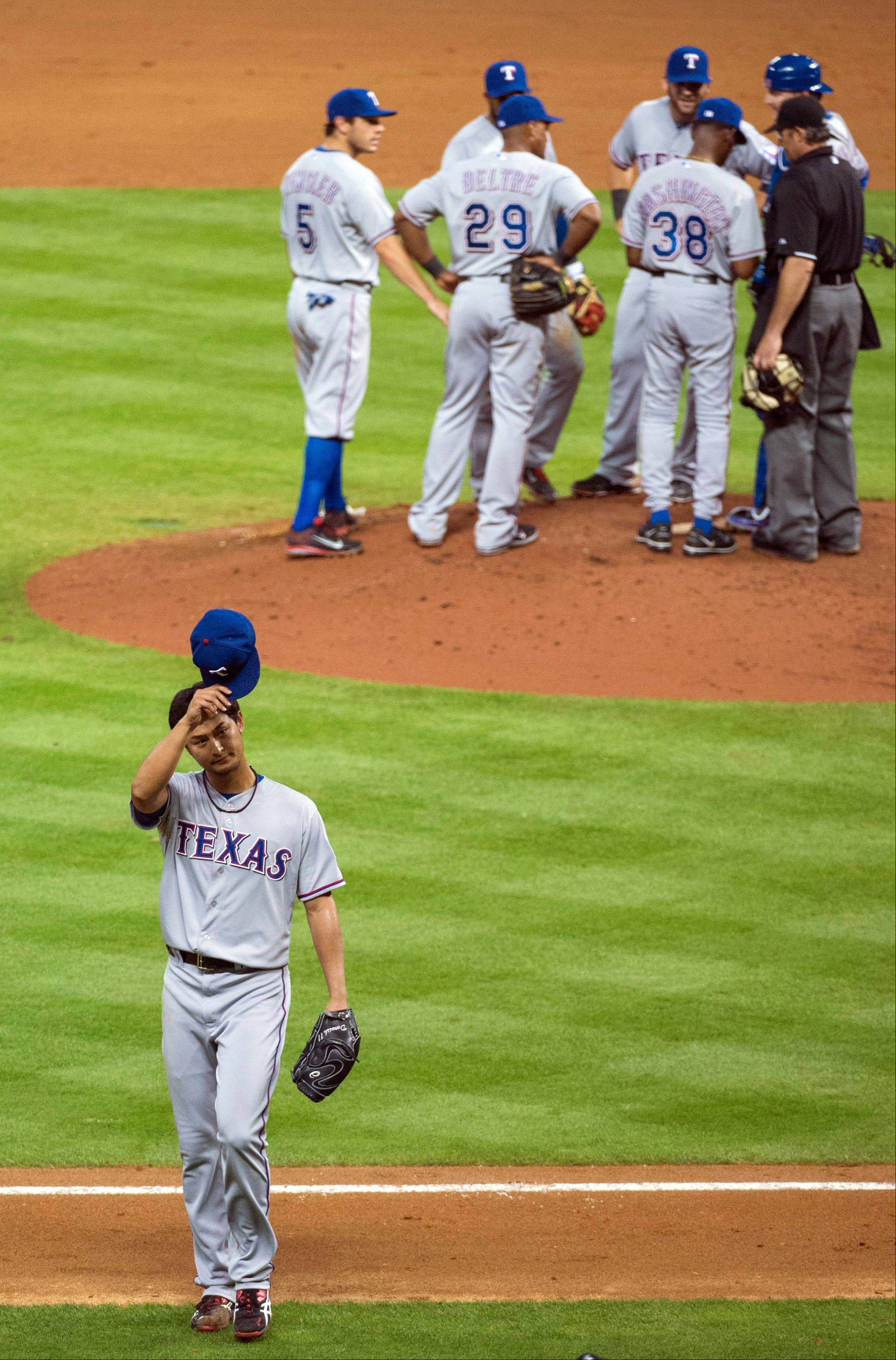 Texas Rangers starting pitcher Yu Darvish tips his cap to the crowd as he leaves the game after surrendering a hit in the bottom of the ninth inning against the Houston Astros at Minute Maid Park on Tuesday, April 2, 2013, in Houston. Darvish pitched nine and two-thirds perfect innings before giving up a hit to Astros' Marwin Gonzalez in the Rangers' 7-0 win. (AP Photo/Houston Chronicle, Smiley N. Pool)