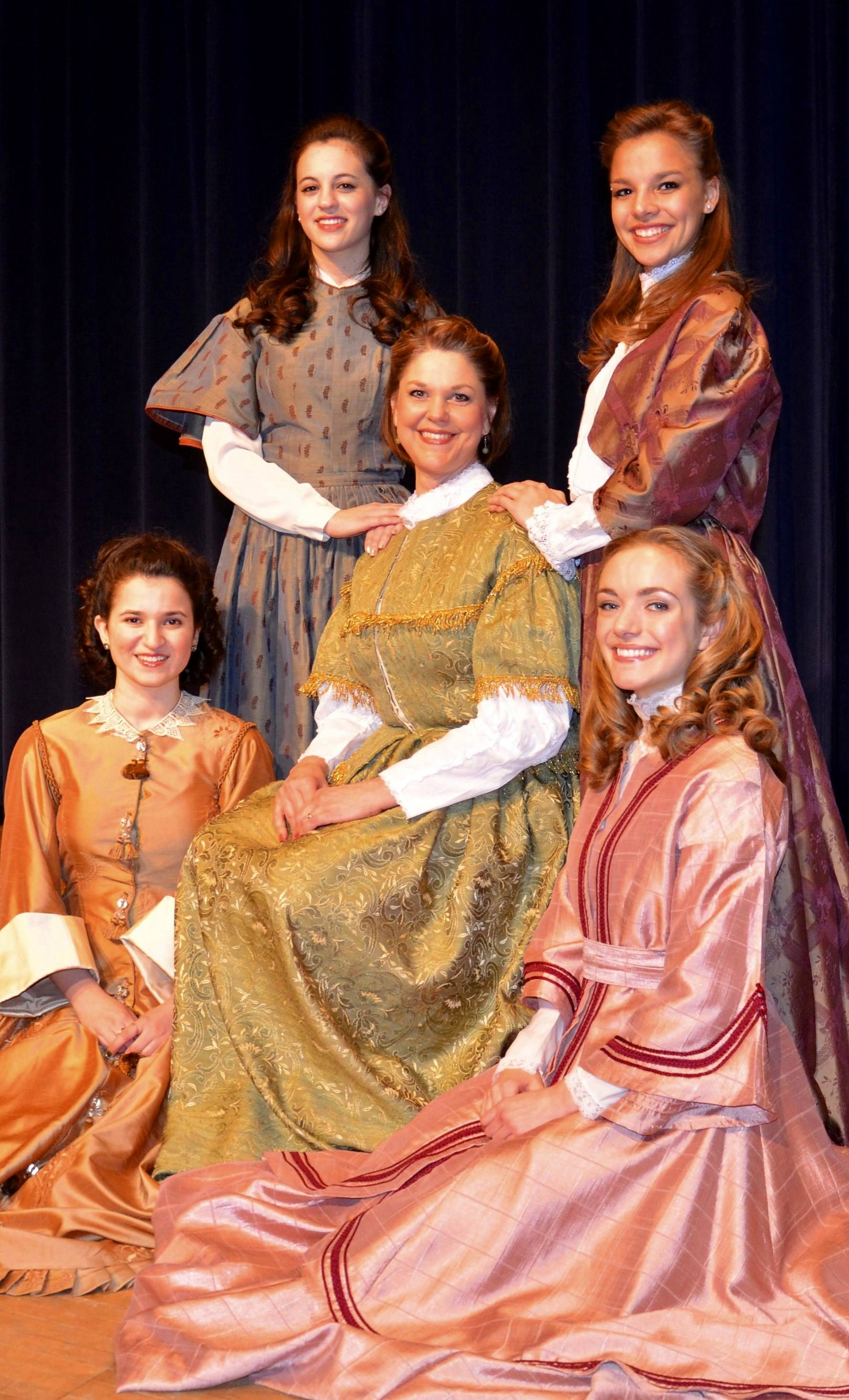 "The March family in Liberty Town Productions' presentation of the Broadway musical, ""Little Women,"" (standing, from left) Sydney Hamilton as Jo, Camille Michelotti at Meg (seated from left) Grace Ferolo as Amy, Lorraine Branham as Marmee and Anne Lowell as Beth."