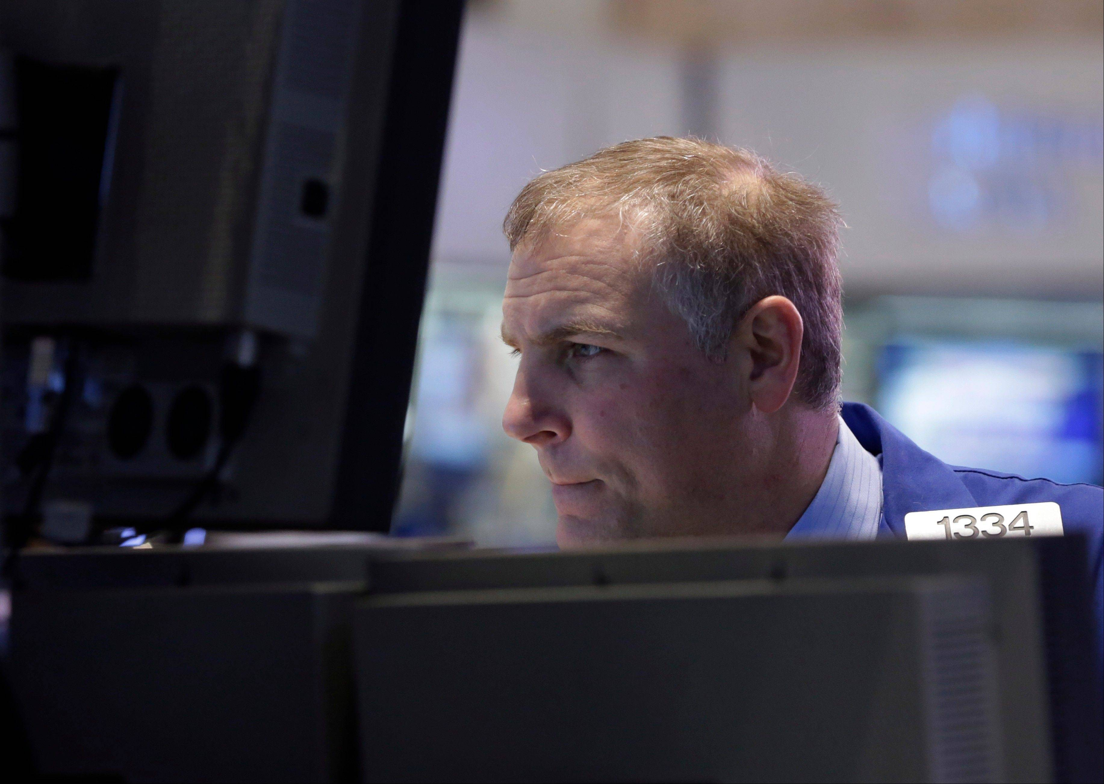 ASSOCIATED PRESSU.S. stocks fell, dragging the Standard & Poor's 500 Index down from a record, as financial and energy shares tumbled after oil plunged and worse-than-estimated data spurred concern over economic growth.