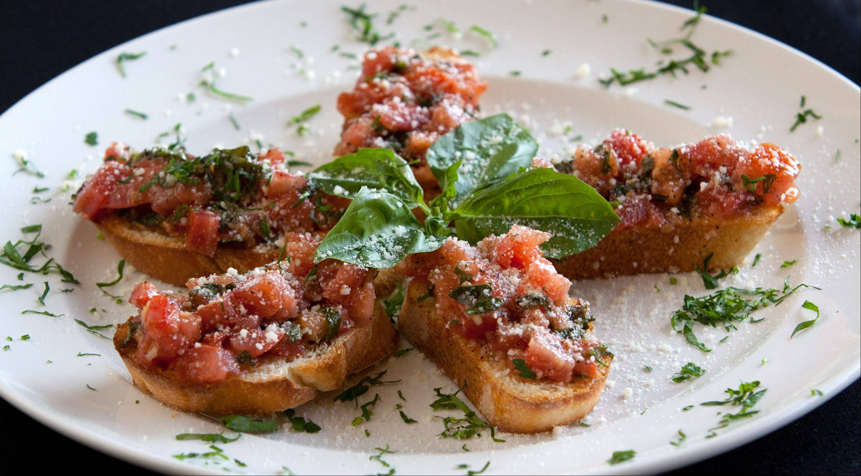Toasted Italian bread topped with fresh plum tomatoes, basil, garlic and olive oil is a nice way to start a meal at Navarro's of Naperville.