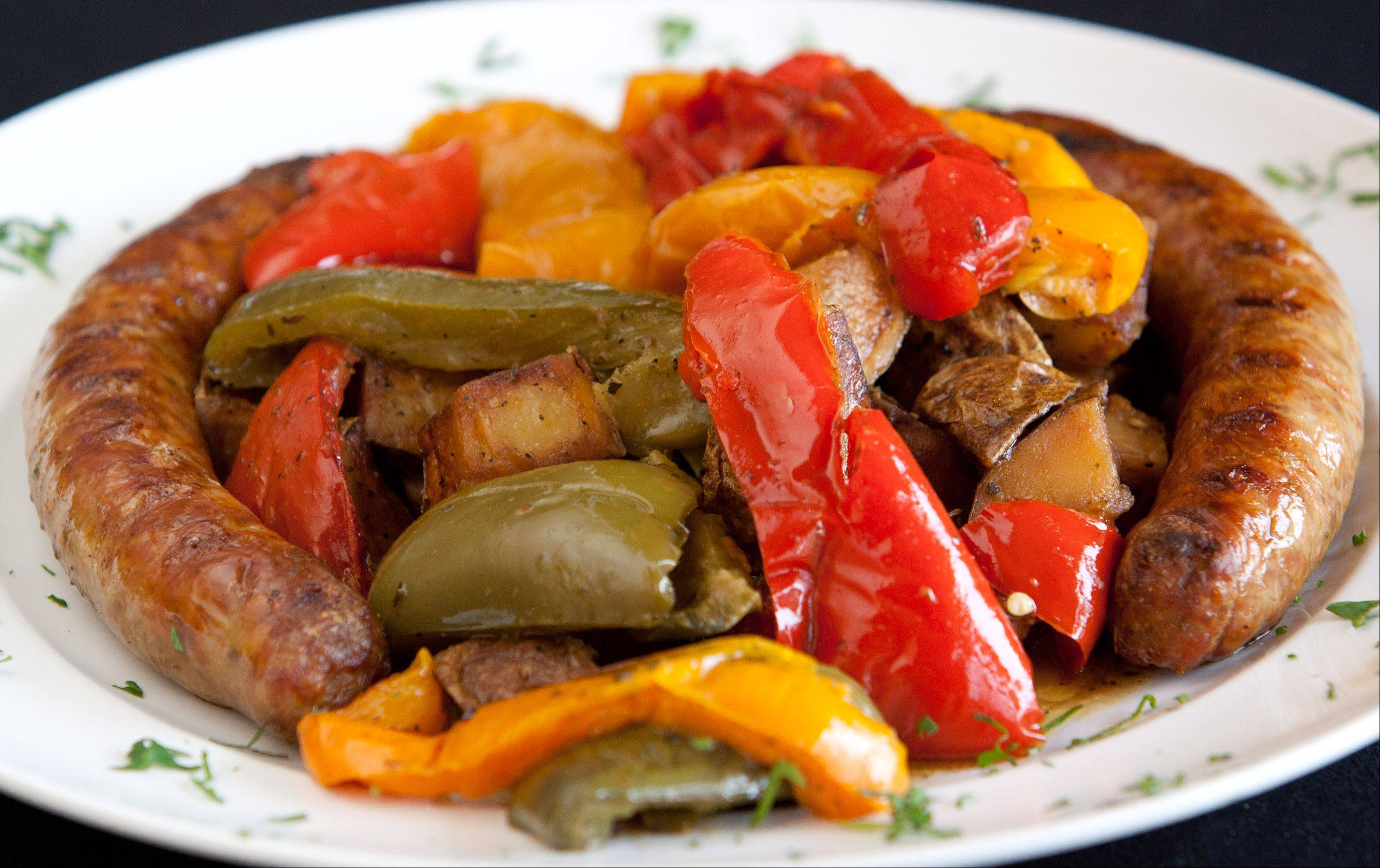 Italian sausage with roasted sweet peppers and potatoes at Navarro's of Naperville.