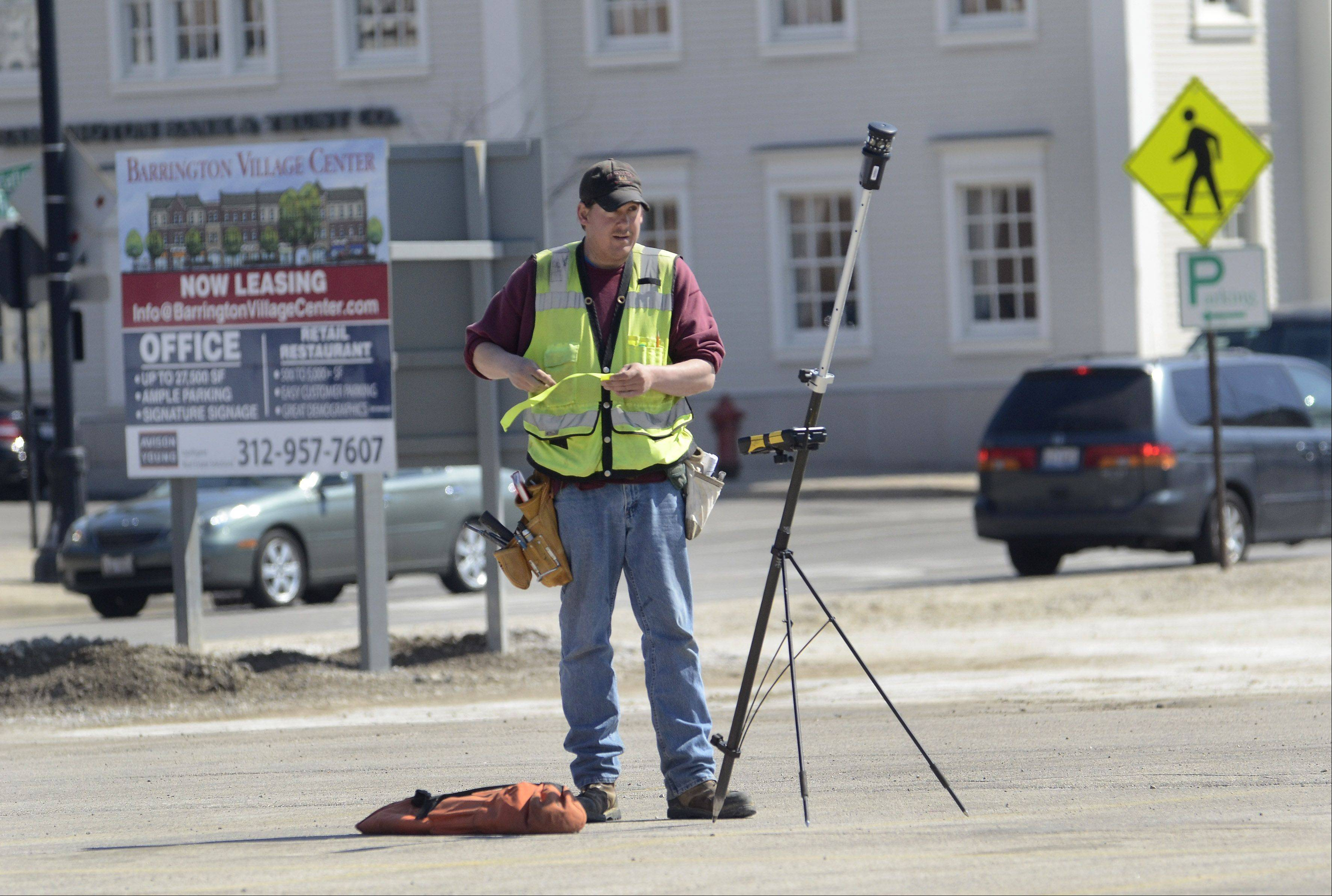 Mark Hamilton of Gewalt Hamilton Associates Inc. surveys the development site Thursday at the southwest corner of Hough and Main Streets in downtown Barrington.