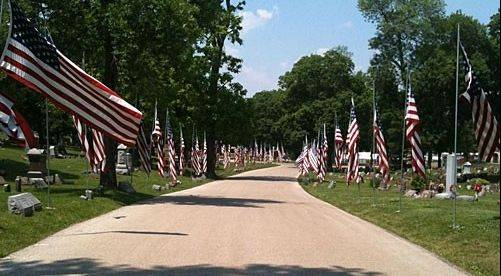 "The Elgin Patriotic Memorial Association, which coordinates the city's Memorial Day programs, seeks donations to replace worn burial flags and many of the smaller flags for veterans' graves. The larger burial flags are part of the cemetery's ""Avenue of Flags."""