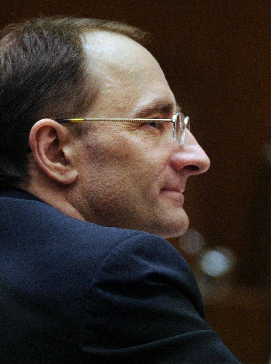 Christian Karl Gerhartsreiter listens during his trial at Clara Shortridge Foltz Criminal Justice Center in Los Angeles. The notorious Rockefeller impostor on trial for murder was linked by a key witness Tuesday to a truck bought by the man he is charged with killing in California more than a quarter-century ago.