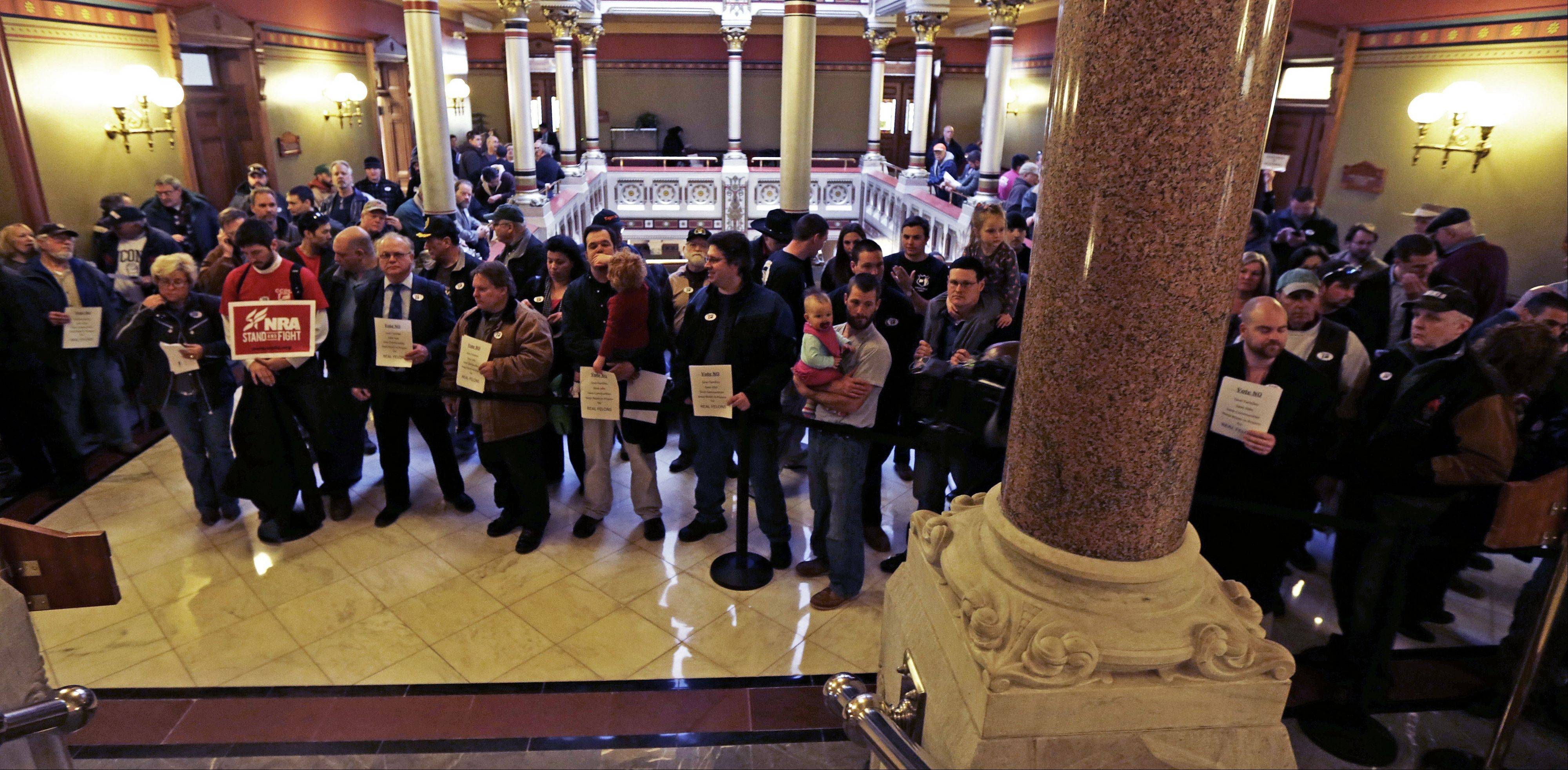 Gun rights advocates fill the hallways of the Capitol in Hartford, Conn., Wednesday, April 3, 2013. Hundreds of gun rights advocates are gathering at the statehouse in Hartford ahead of a vote in the General Assembly on proposed gun-control legislation.