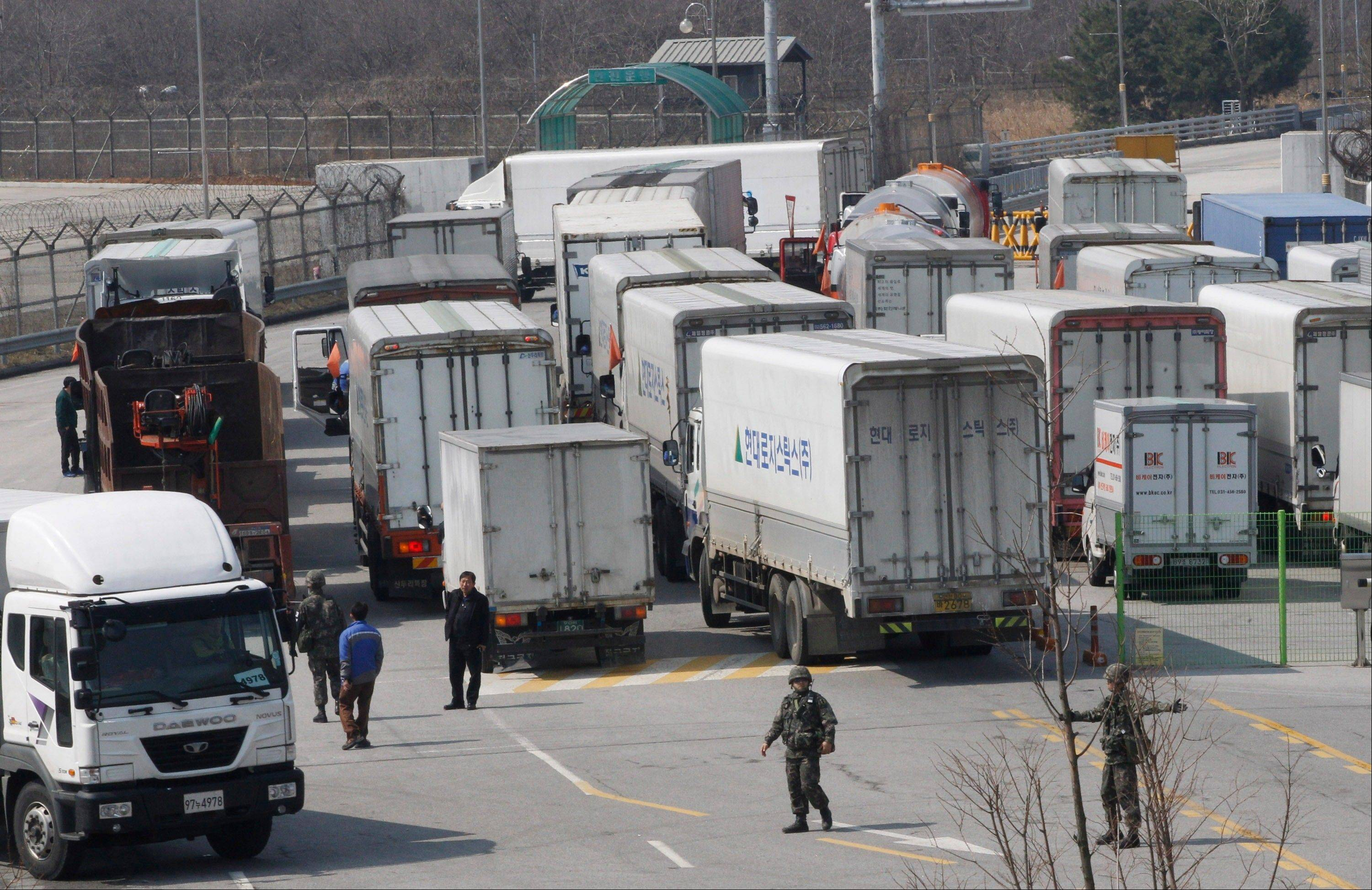 South Korean army soldiers gesture to turn back vehicles as they were refused to enter to Kaesong, North Korea, at the customs, immigration and quarantine office in Paju, South Korea, near the border village of Panmunjom, Wednesday, April 3, 2013. North Korea on Wednesday barred South Korean workers from entering the jointly run factory park just over the heavily armed border in the North, officials in Seoul said, a day after Pyongyang announced it would restart its long-shuttered plutonium reactor and increase production of nuclear weapons material.