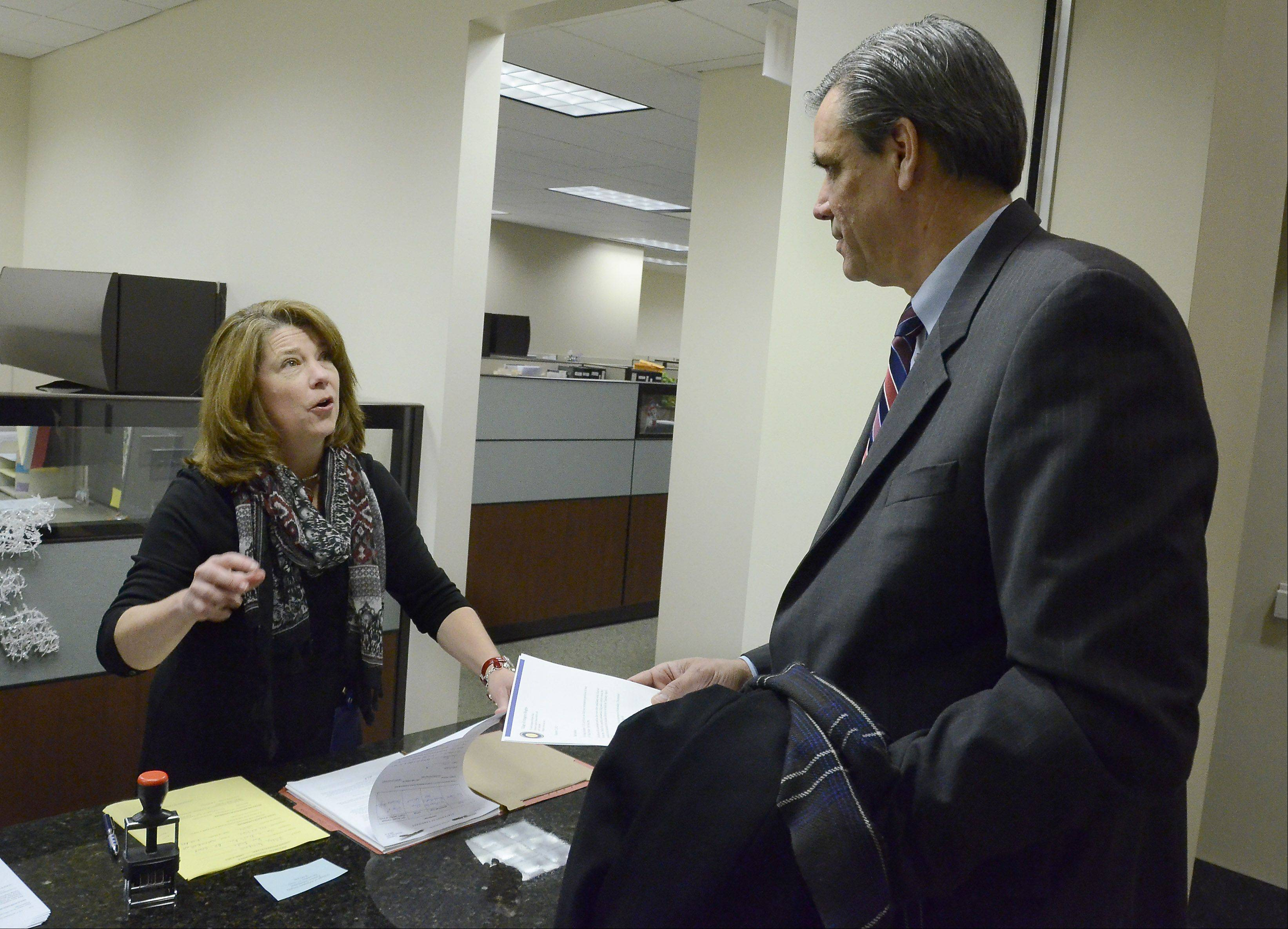 Ron Drake is the first mayoral candidate to file with Arlington Heights Village Clerk Rebecca Hume on Dec. 18.