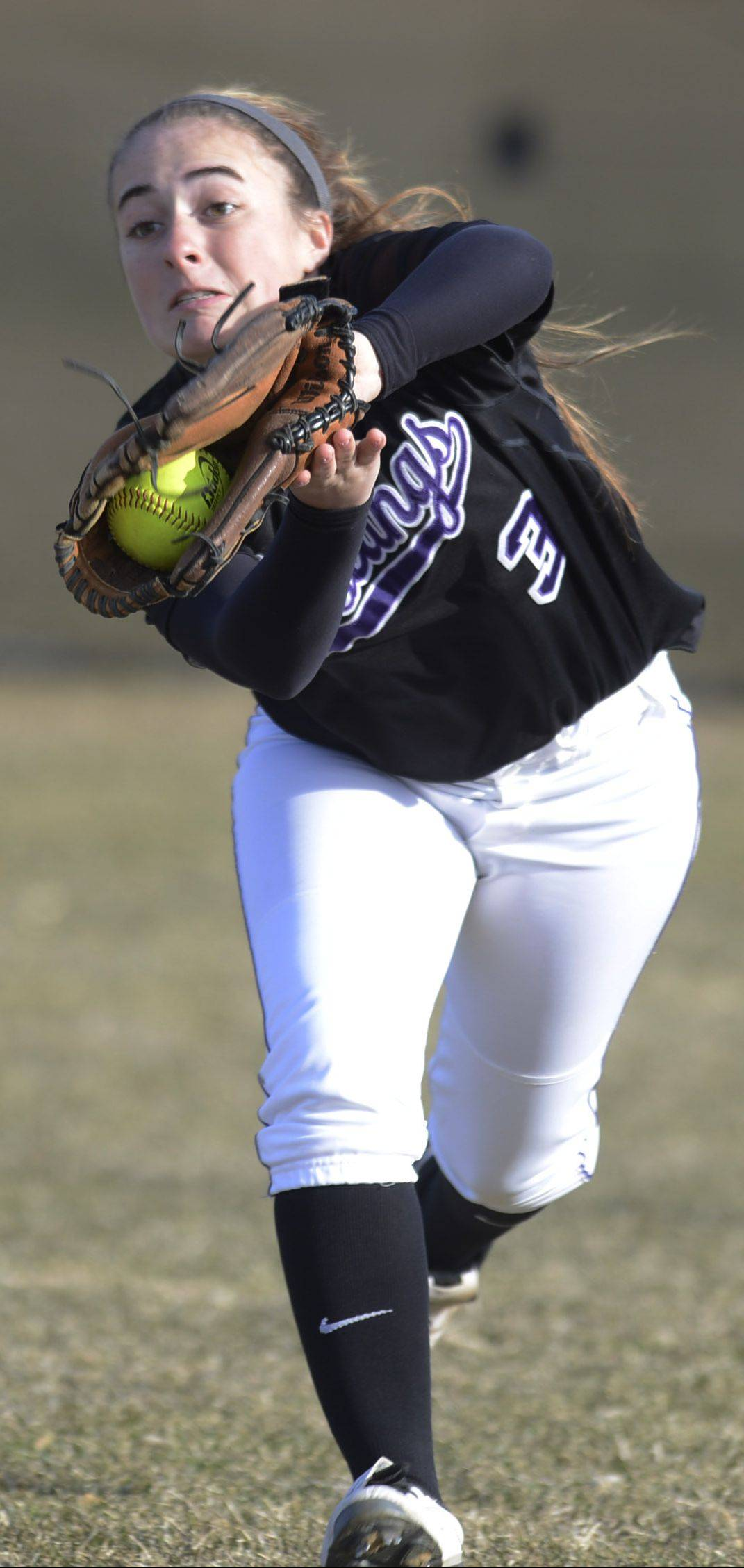 Rolling Meadows right fielder Maddie Morgan makes a running catch during Wednesday's game against Huntley.