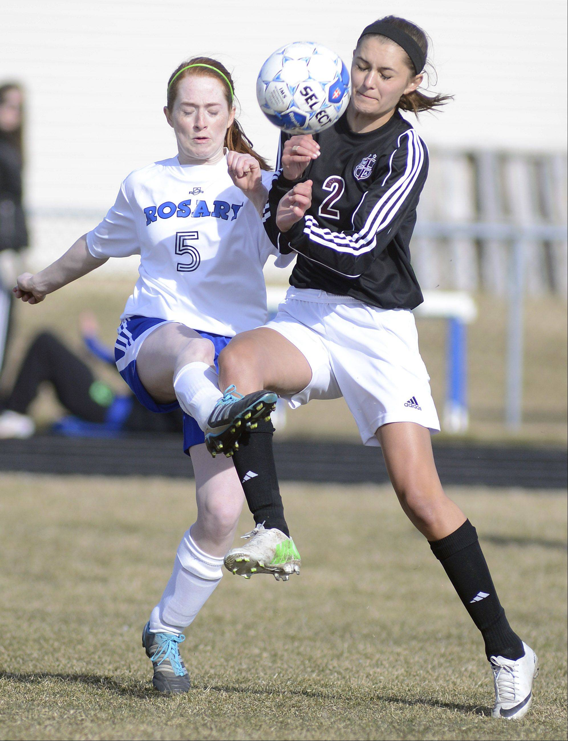 Rosary's Haley Kilbride and Wheaton Academy's Molly Thorson collide while fighting for possession of the ball in the first half on Wednesday, April 3.