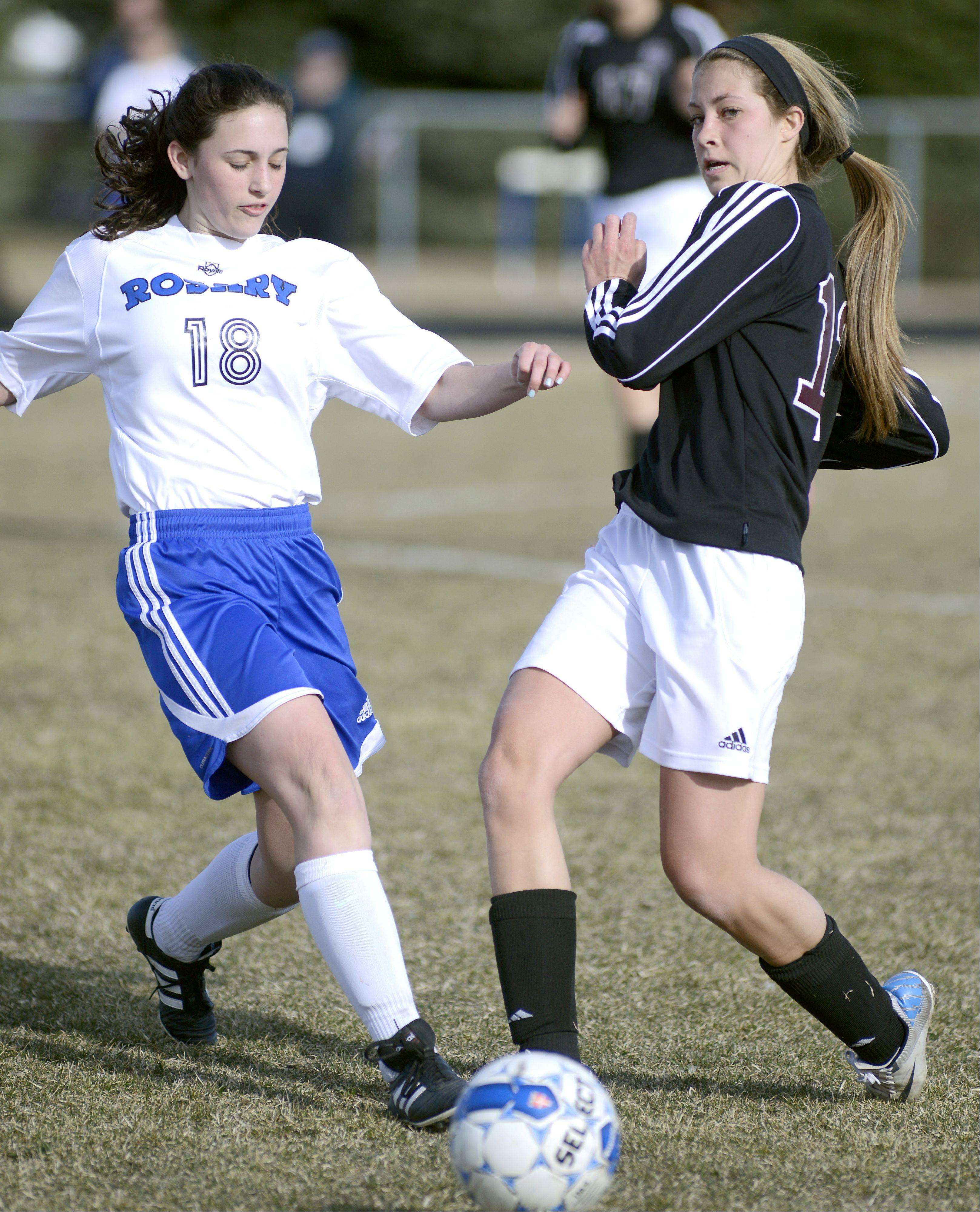 Wheaton Academy's Emily Mascari kicks the ball before Rosary's Anna Sheen can get to it in the first half on Wednesday, April 3.