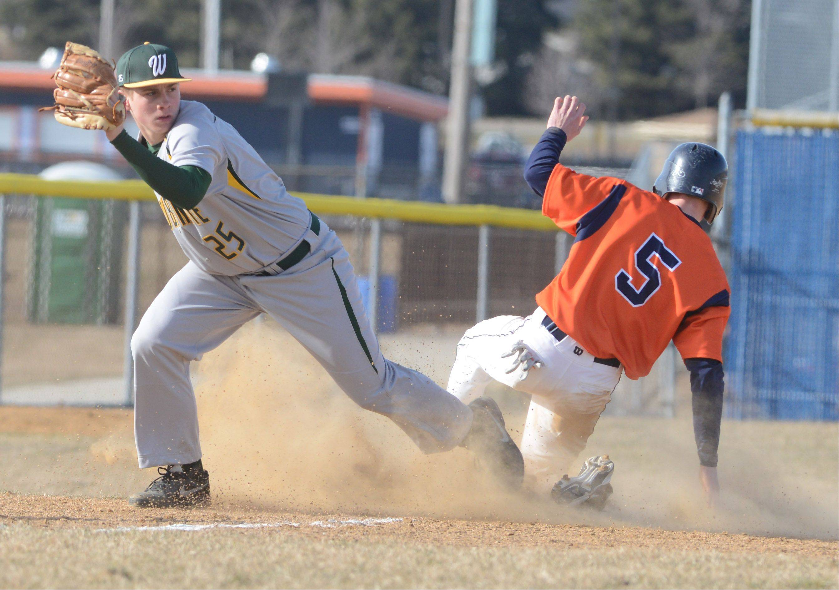 Ben Vietri of Waubonsie forces out Josh Harrington of Naperville North at third. This took place during the Waubonsie Valley at Naperville North baseball game Wednesday.