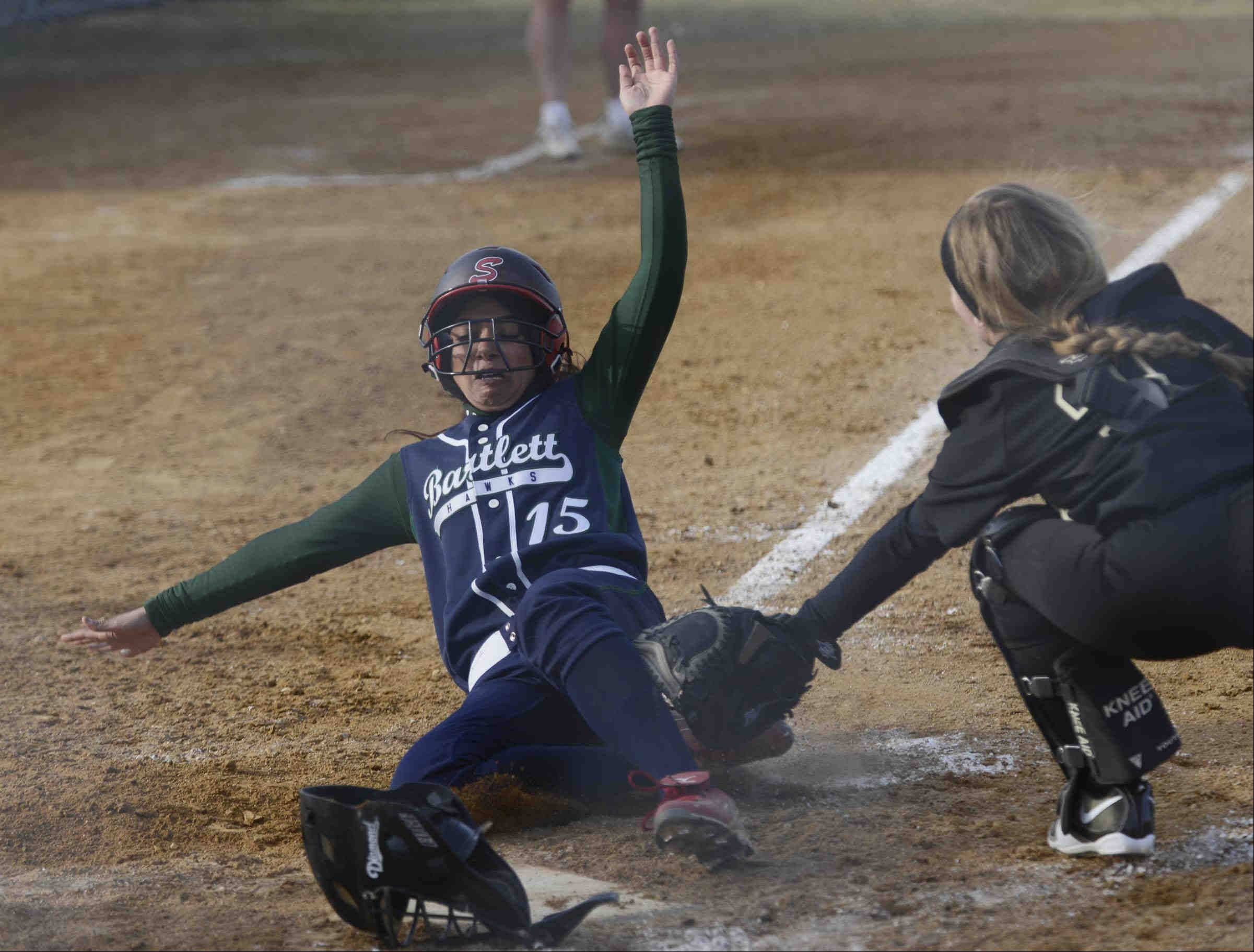 Bartlett's Rheya Upadhyaya is caught at the plate by Streamwood catcher Natalie Filippo Wednesday in Bartlett.