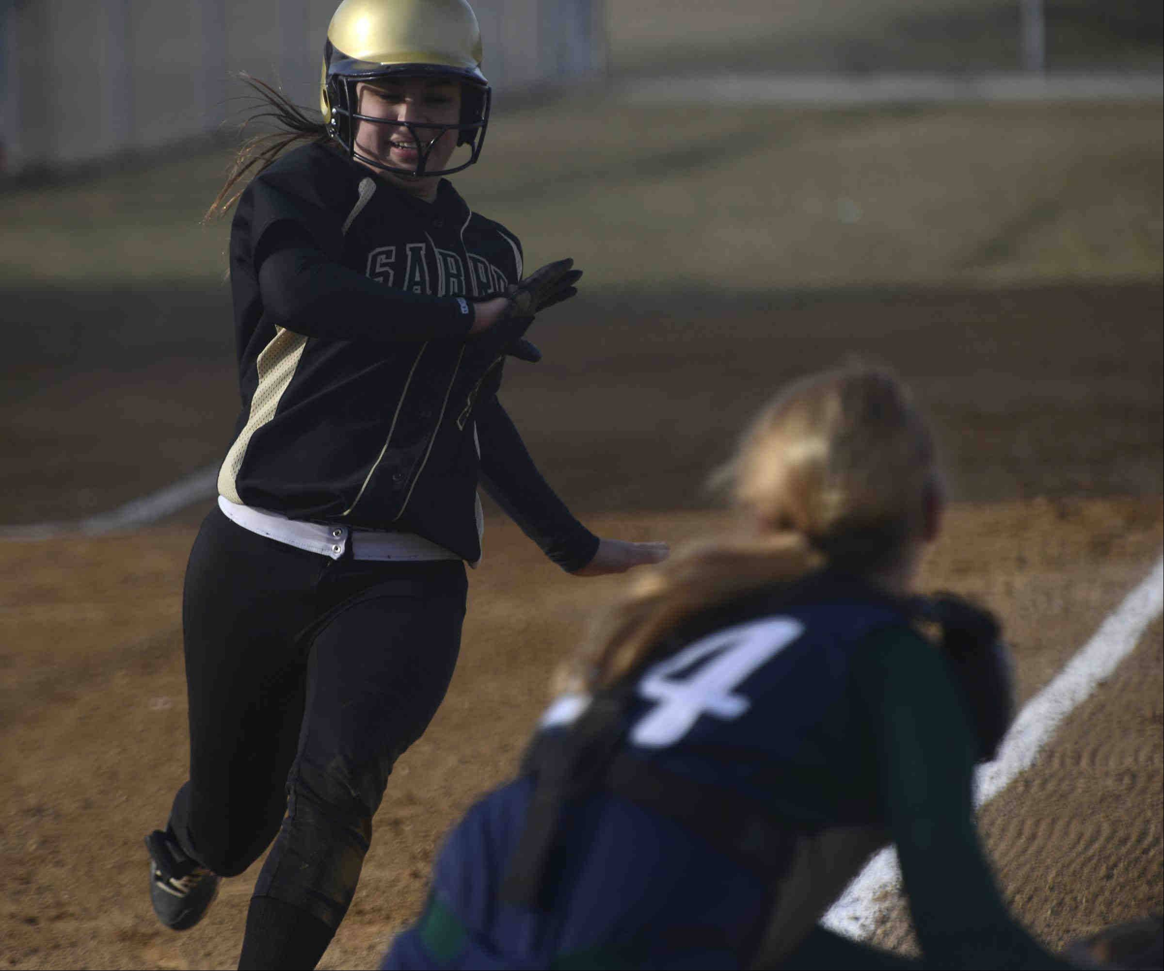 Bartlett catcher Lauren Janczak has the ball ready as Streamwood's Olivia Reyna bears down on the plate Wednesday in Bartlett. She was out.