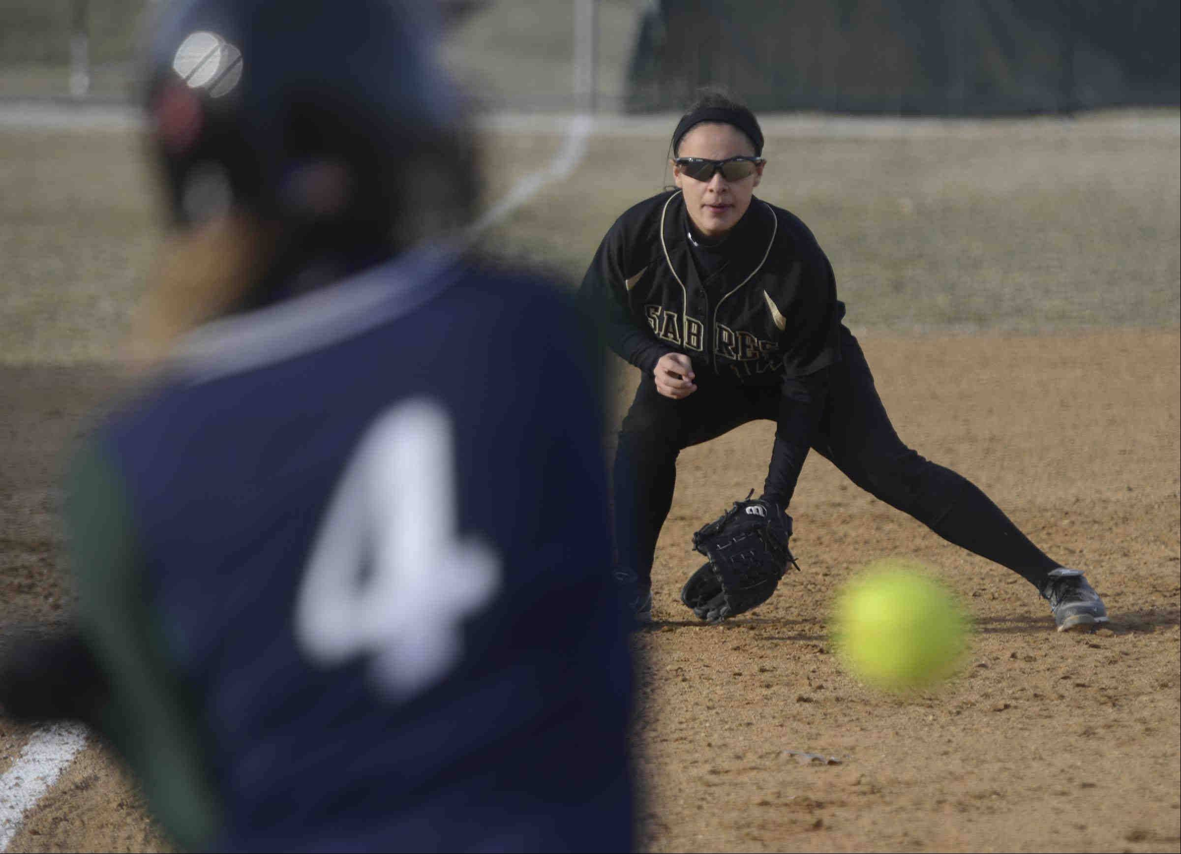Streamwood third baseman Brittany Delao waits on Bartlett hitter Jessica Kirby Wednesday in Bartlett.