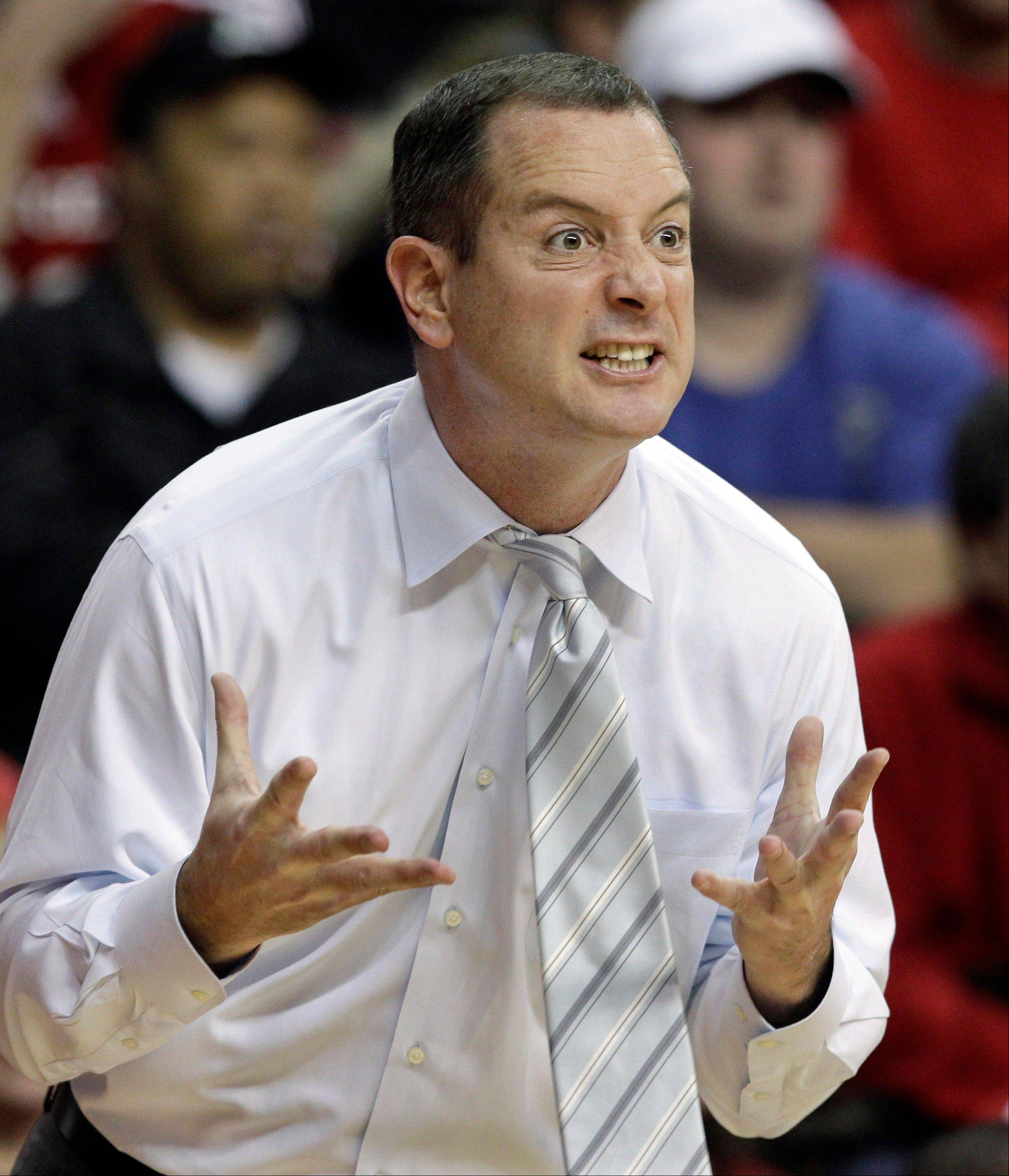 FILE - In this Jan. 7, 2012, file photo, Rutgers coach Mike Rice reacts to play during an NCAA college basketball game against Connecticut in Piscataway, N.J. The airing Tuesday, April 2, 2013, of a videotape of Rice using gay slurs, shoving and grabbing his players and throwing balls at them in practice over the past three seasons has Rutgers athletic director Tim Pernetti reconsidering his decision not to fire the coach. Pernetti was given a copy of the video in late November by a disgruntled former employee, and he suspended Rice for three games, fined him $50,000 and made him undergo anger management classes for inappropriate behavior after investigating it.