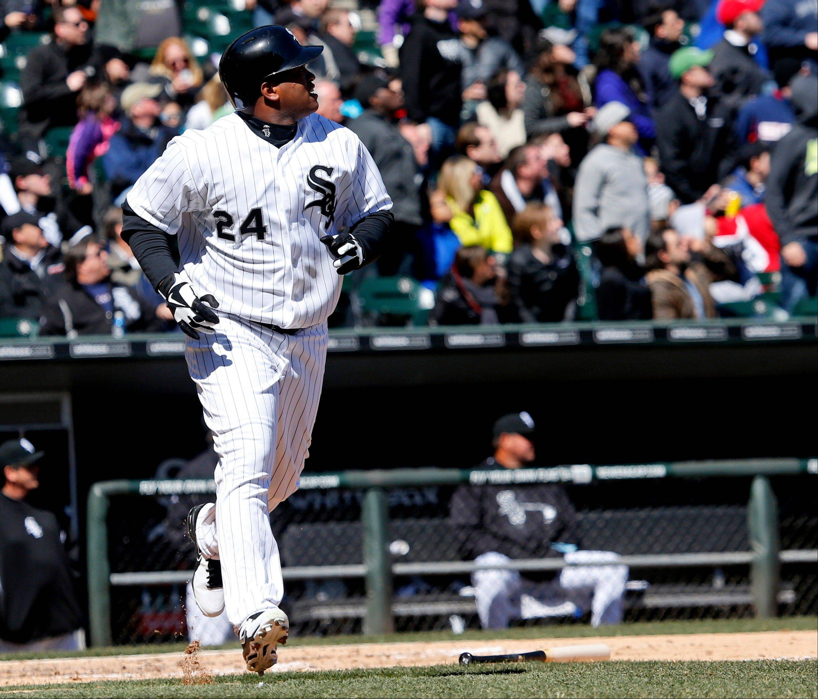 Chicago White Sox's Dayan Viciedo watches his two-run home run off Kansas City Royals starting pitcher Ervin Santana during the fourth inning of a baseball game Wednesday, April 3, 2013, in Chicago.