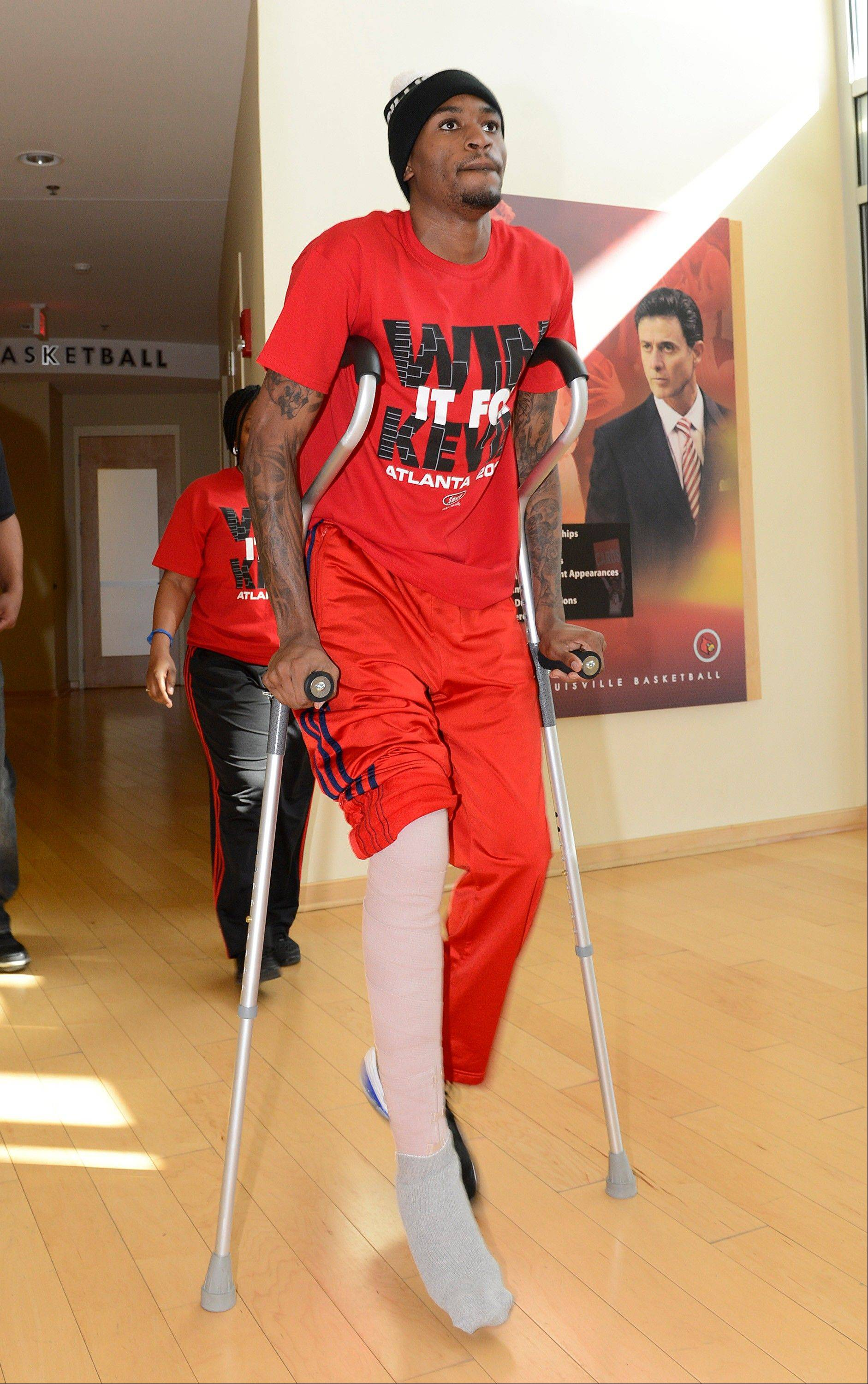 Louisville basketball player Kevin Ware arrives for an interview Wednesday April 3, 2013, at the KFC Yum! Center practice facility in Louisville, Ky. Ware was released from an Indianapolis hospital Tuesday, two days after millions watched him break his right leg on a horrifying play trying to block a shot during an NCAA college basketball regional championship game against Duke.