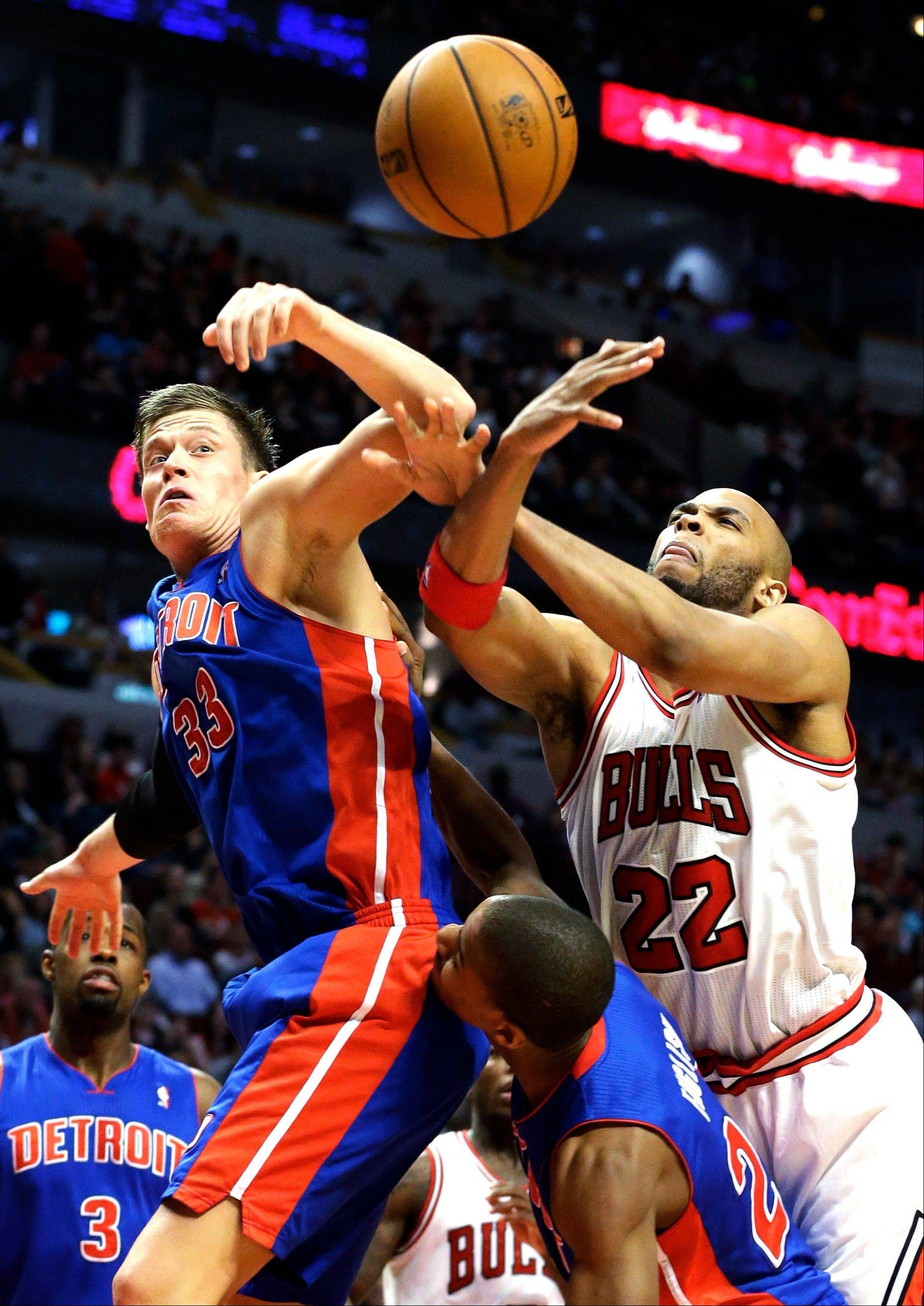 Taj Gibson, right, and Detroit Pistons forward Jonas Jerebko battle for a rebound during the Bulls' win over Detroit on Sunday. Gibson re-injured his knee Tuesday in Washington, and his return for the playoffs is in doubt.