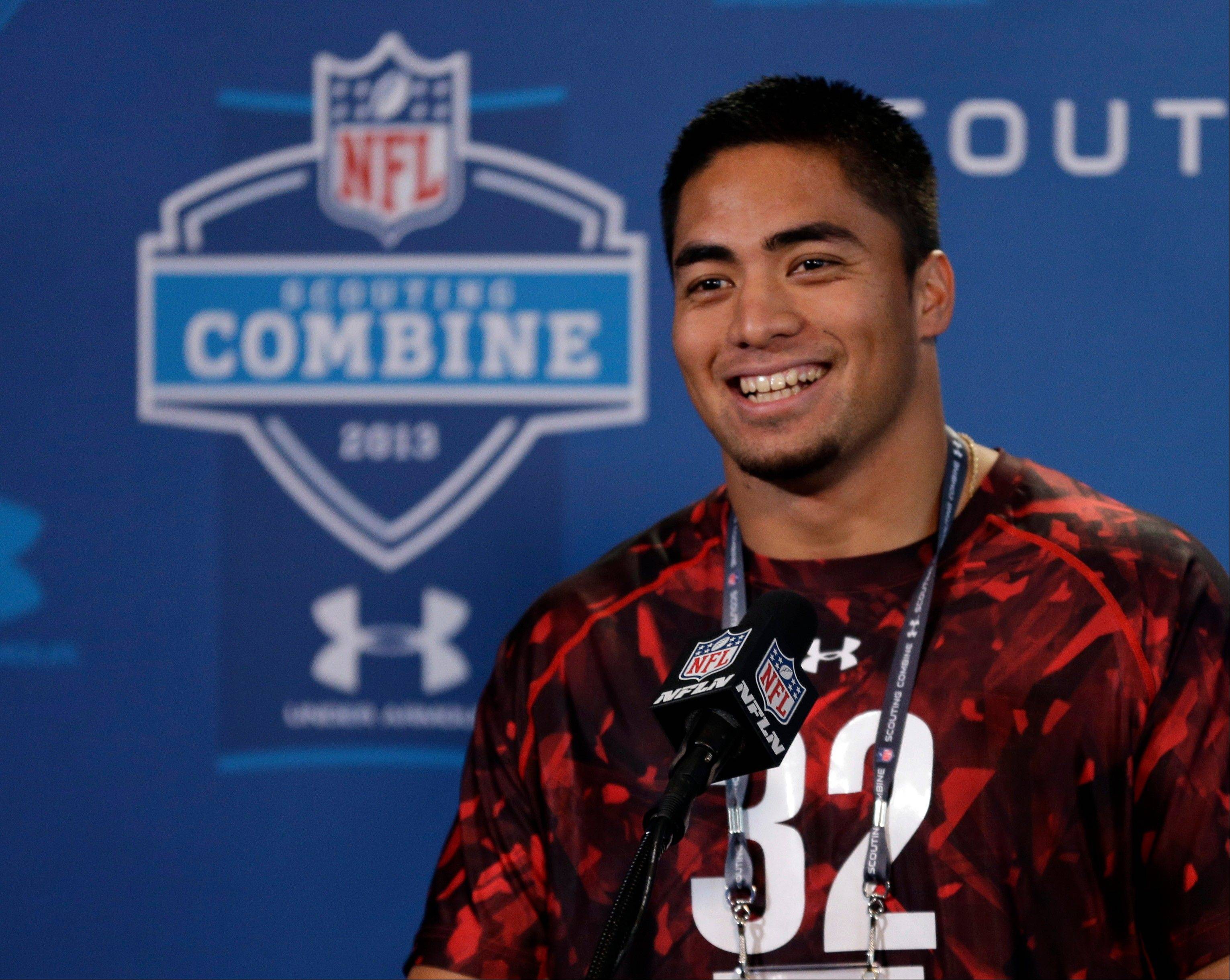 Notre Dame linebacker Manti Te'O answers a question during at the NFL football scouting combine in Indianapolis.
