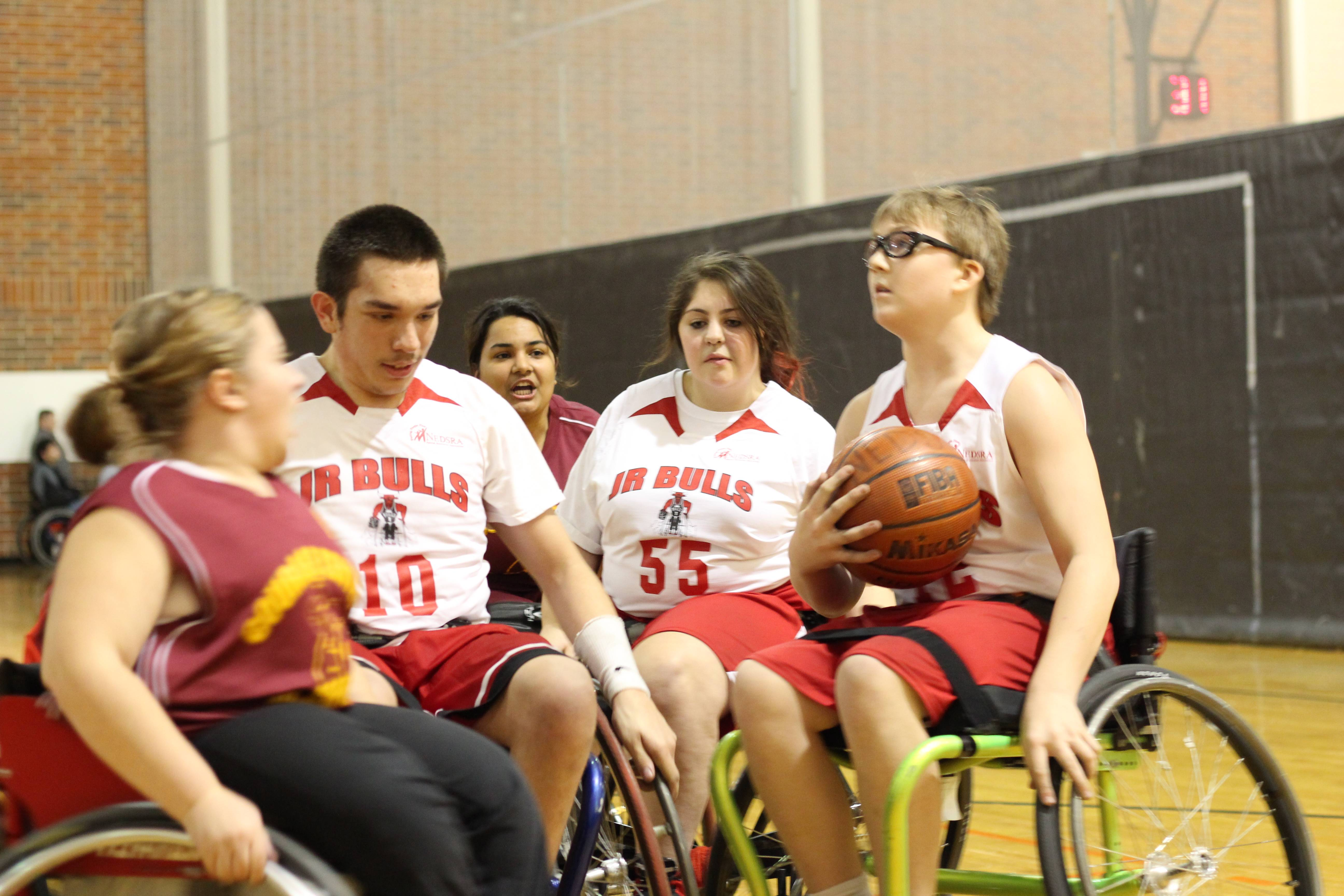 Addison players Ryan Glatchak, Nick Trojanowicz, and Melissa Schaefer play an exhibition wheelchair basketball game, against the Addison Police Department, this Sunday, April 7th at Addison Trail High School to raise money for their upcoming trip to Louisville for the National Championship.