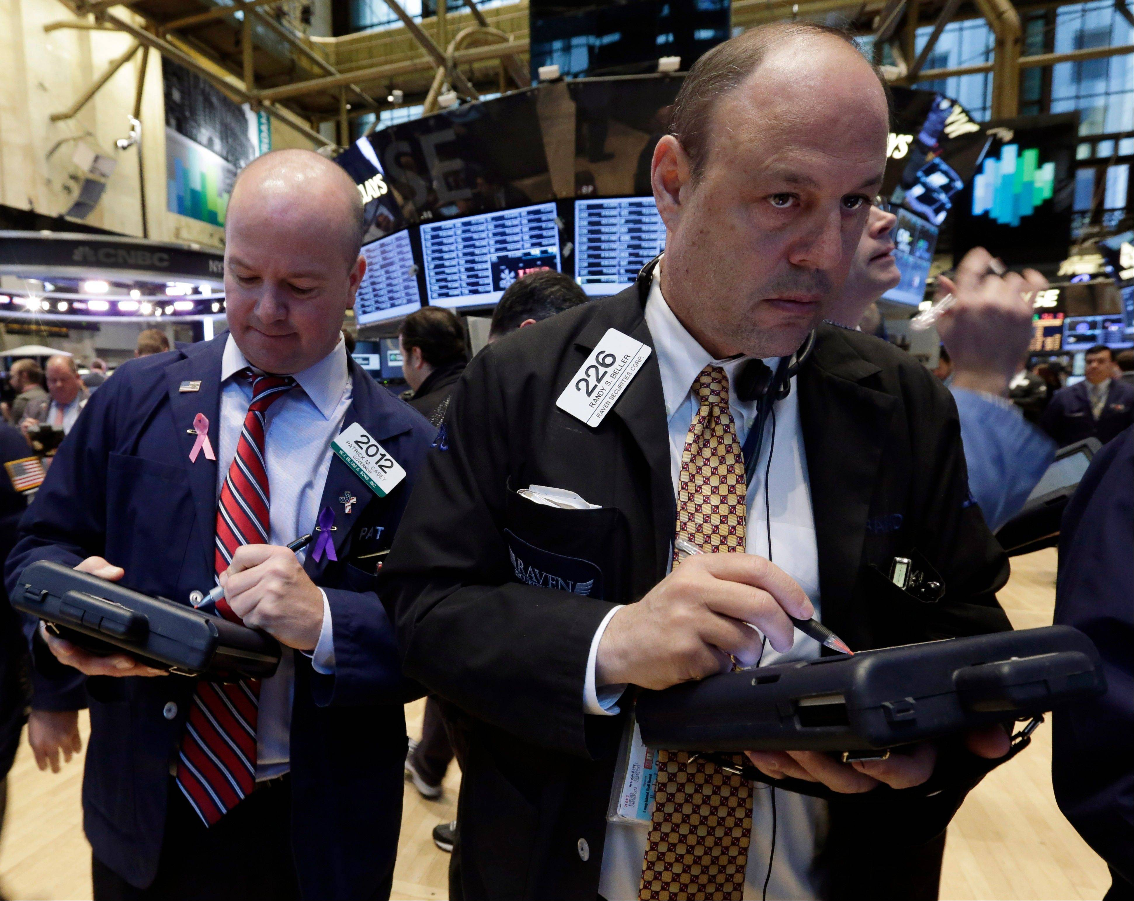 U.S. stocks fluctuated between gains and losses as investors weighed central banks� pledges on stimulus efforts against a rise in American jobless claims.
