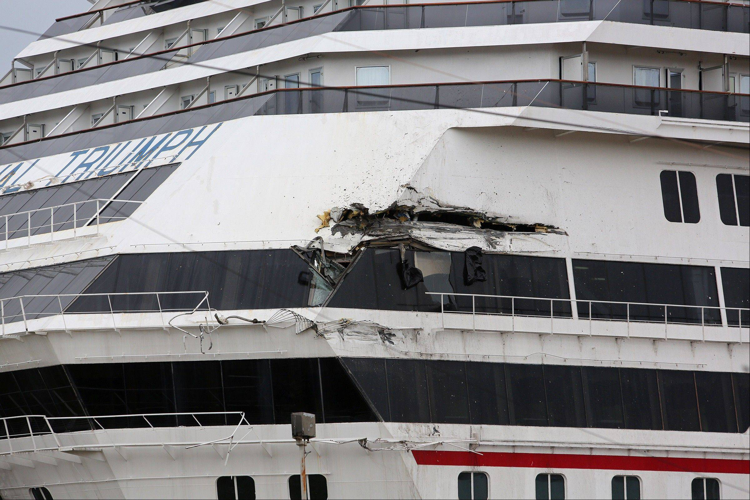 The Carnival cruise ship Triumph is damaged after the being dislodged from its mooring at BAE shipyard during high winds Wednesday, April 3, 2013 in Mobile, Ala. Triumph was disabled Feb. 10 by an engine fire that stranded thousands of passengers onboard for days in the Gulf. It was towed into port in Mobile.