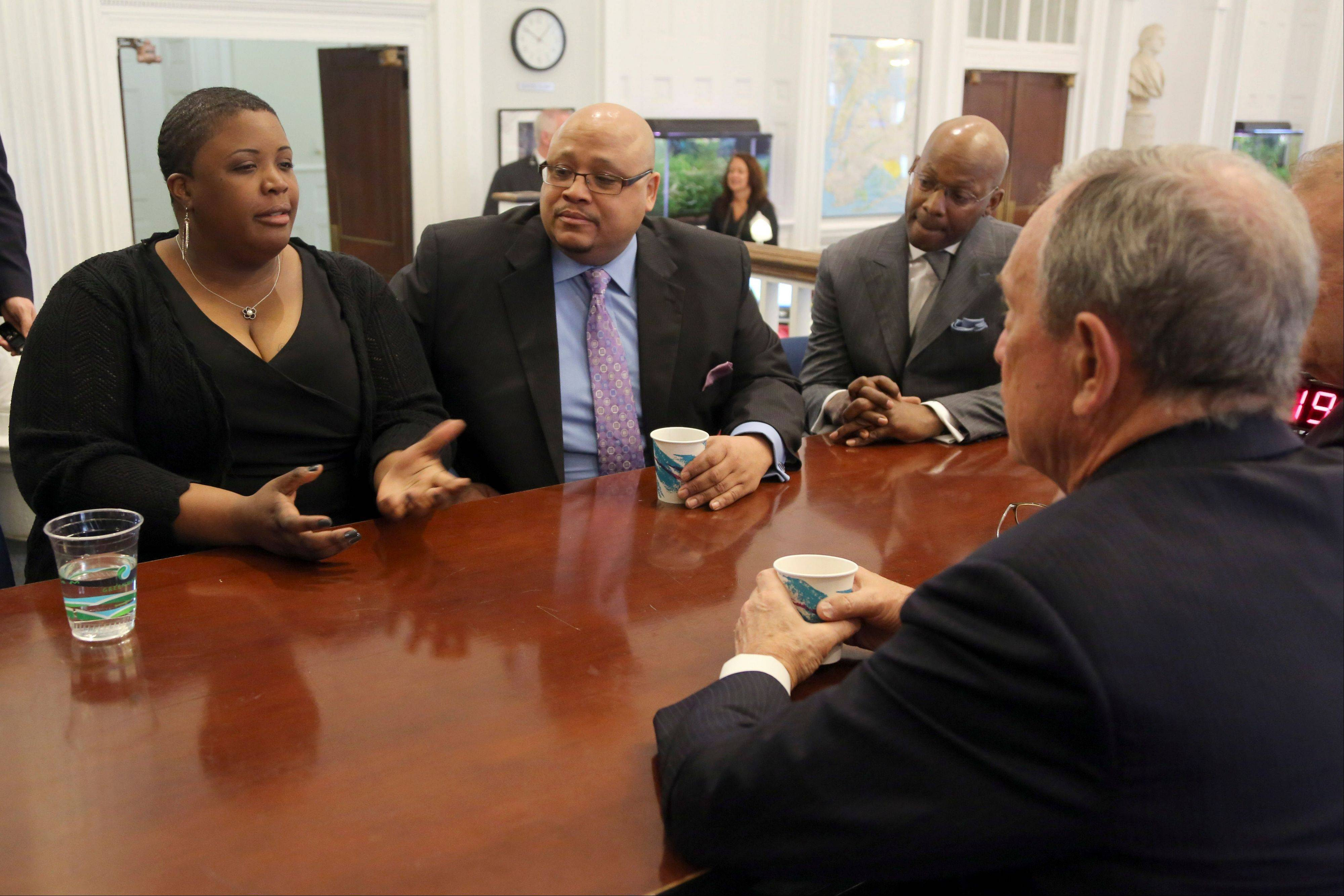 New York City Mayor Michael Bloomberg, foreground, meets with Cleopatra Cowley-Pendleton, left, and Nathaniel A. Pendleton Sr., center, and Van Vincent, Thursday in New York. The Pendletons are the parents of Hadiya Pendleton, who performed at President Obama�s inauguration and was shot and killed in Chicago in February. She was 15 years old. Cowley-Pendleton and Pendleton recently filmed a television commercial for the Mayor�s anti-gun violence coalition. Vincent is a cousin of Hadiya�s.