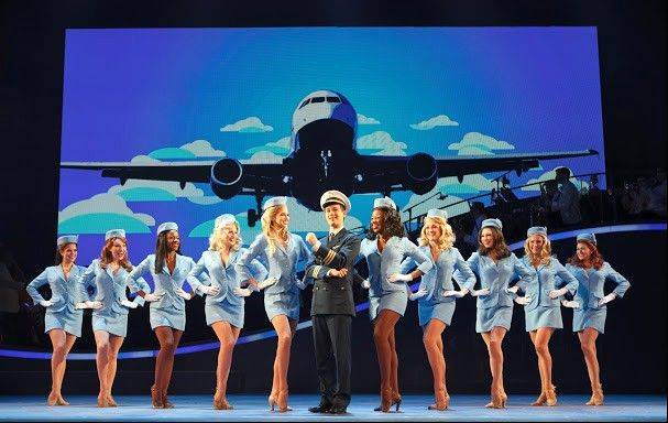 "Stephen Anthony, center, stars as teenage con artist Frank Abagnale, Jr. in Broadway in Chicago's ""Catch Me If You Can."""