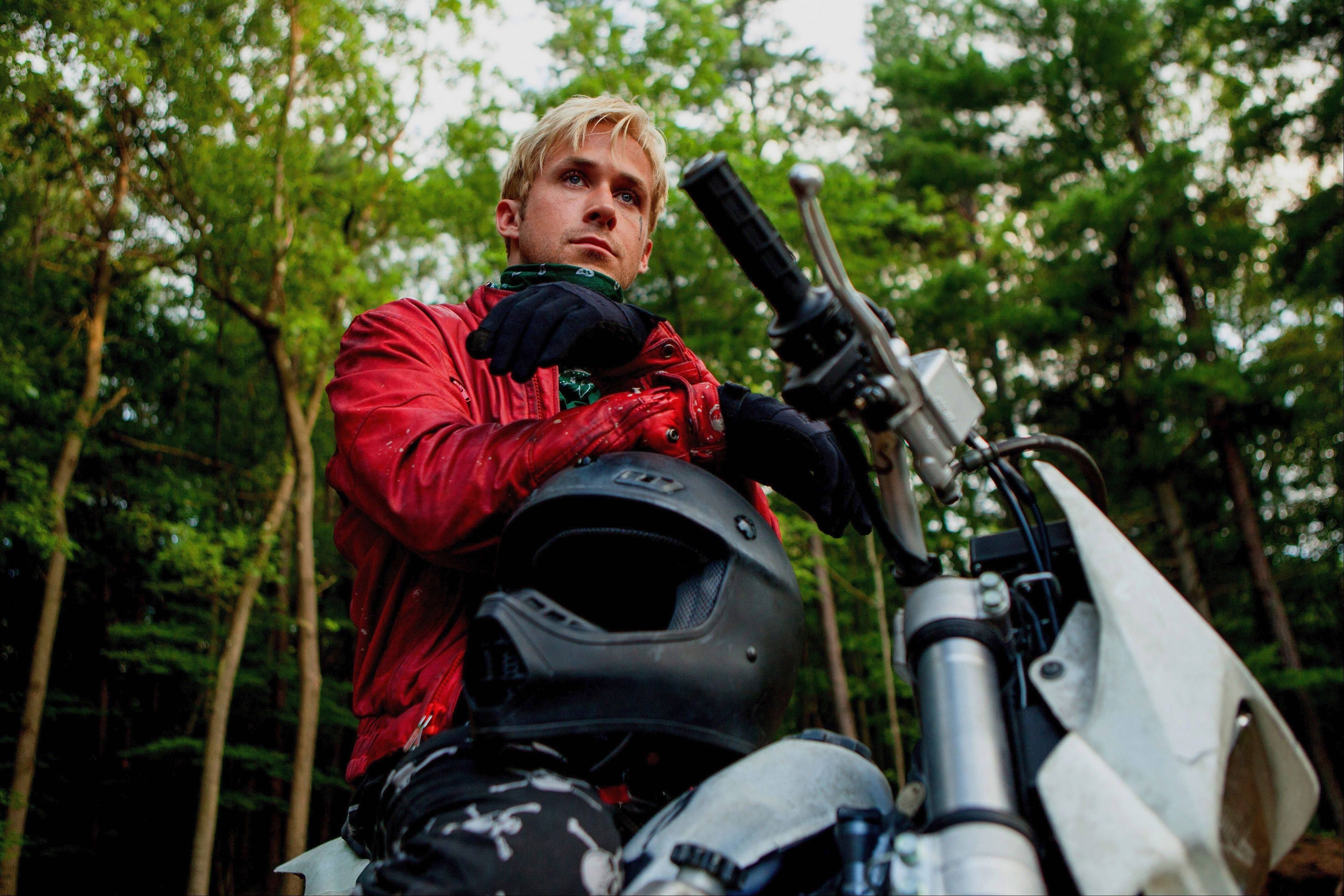 "A stunt bike rider (Ryan Gosling) finds out he has a son and turns to crime to support him in ""The Place Beyond the Pines."""