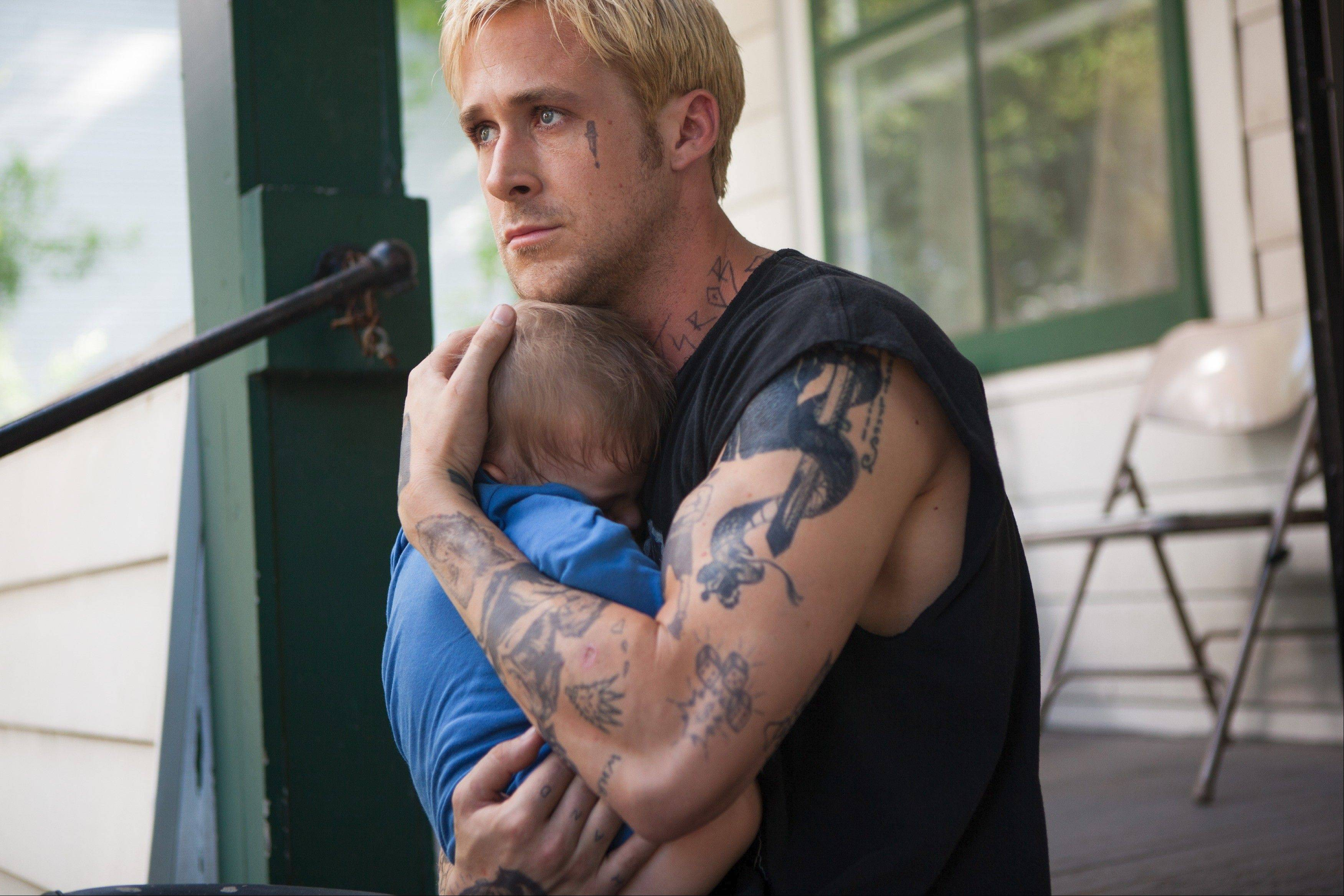 "Luke (Ryan Gosling) turns to illegal means to support his infant son in ""The Place Beyond the Pines."""