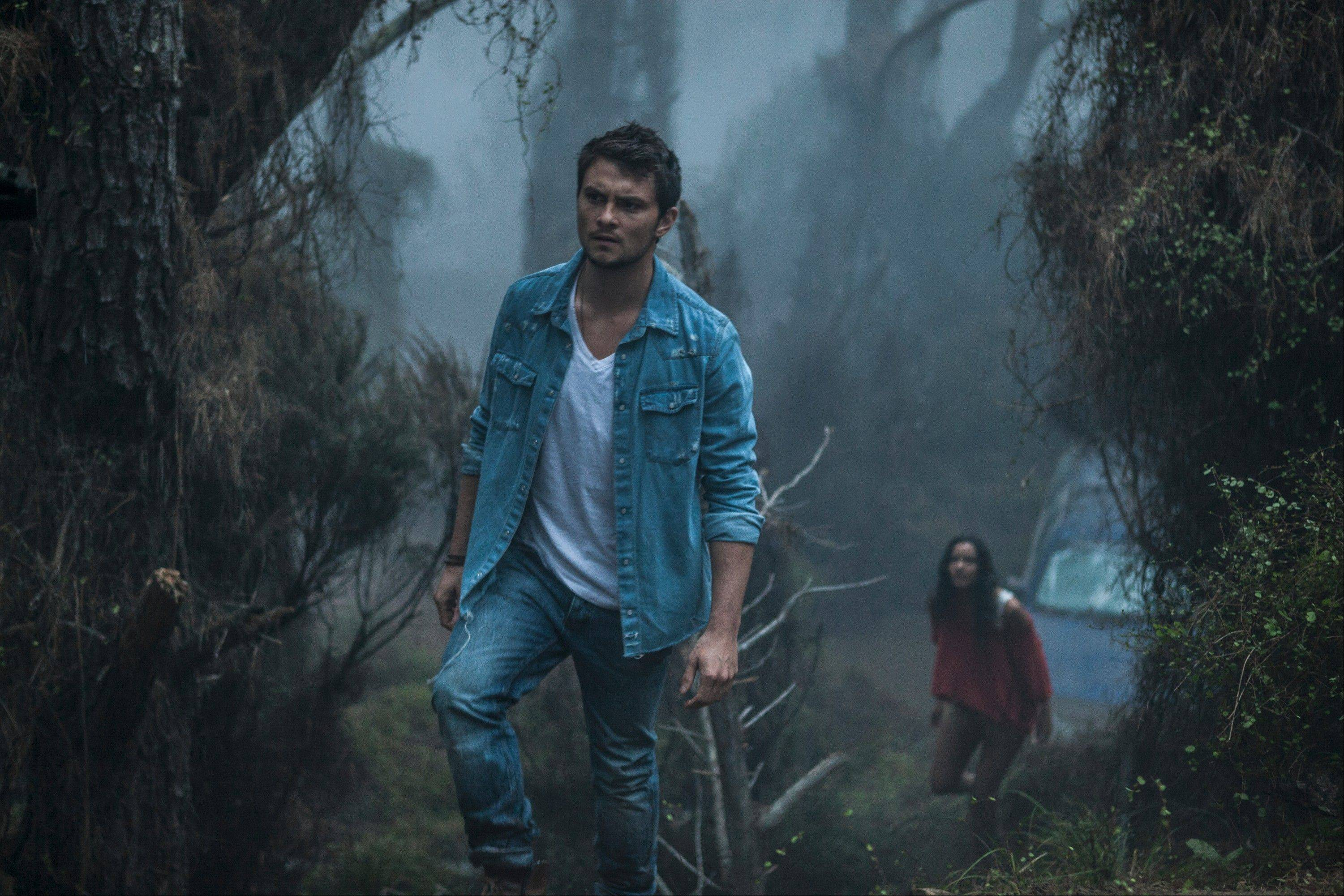 Shiloh Fernandez and Jessica Lucas in TriStar Pictures' horror EVIL DEAD.