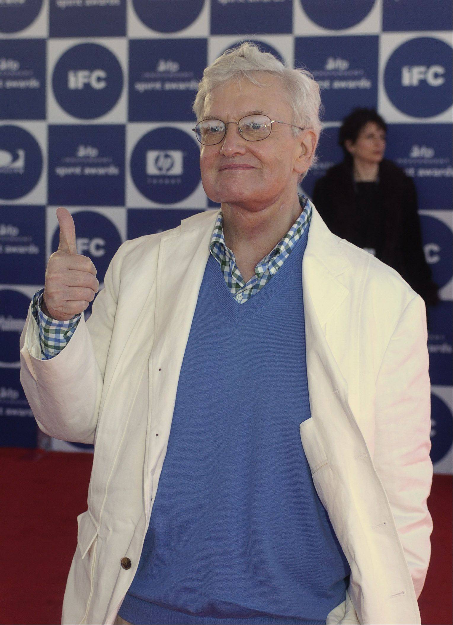 Roger Ebert gives a thumbs up as he arrives for the 2004 IFP Independent Spirit Awards In Santa Monica, Calif., on Feb. 28, 2004.