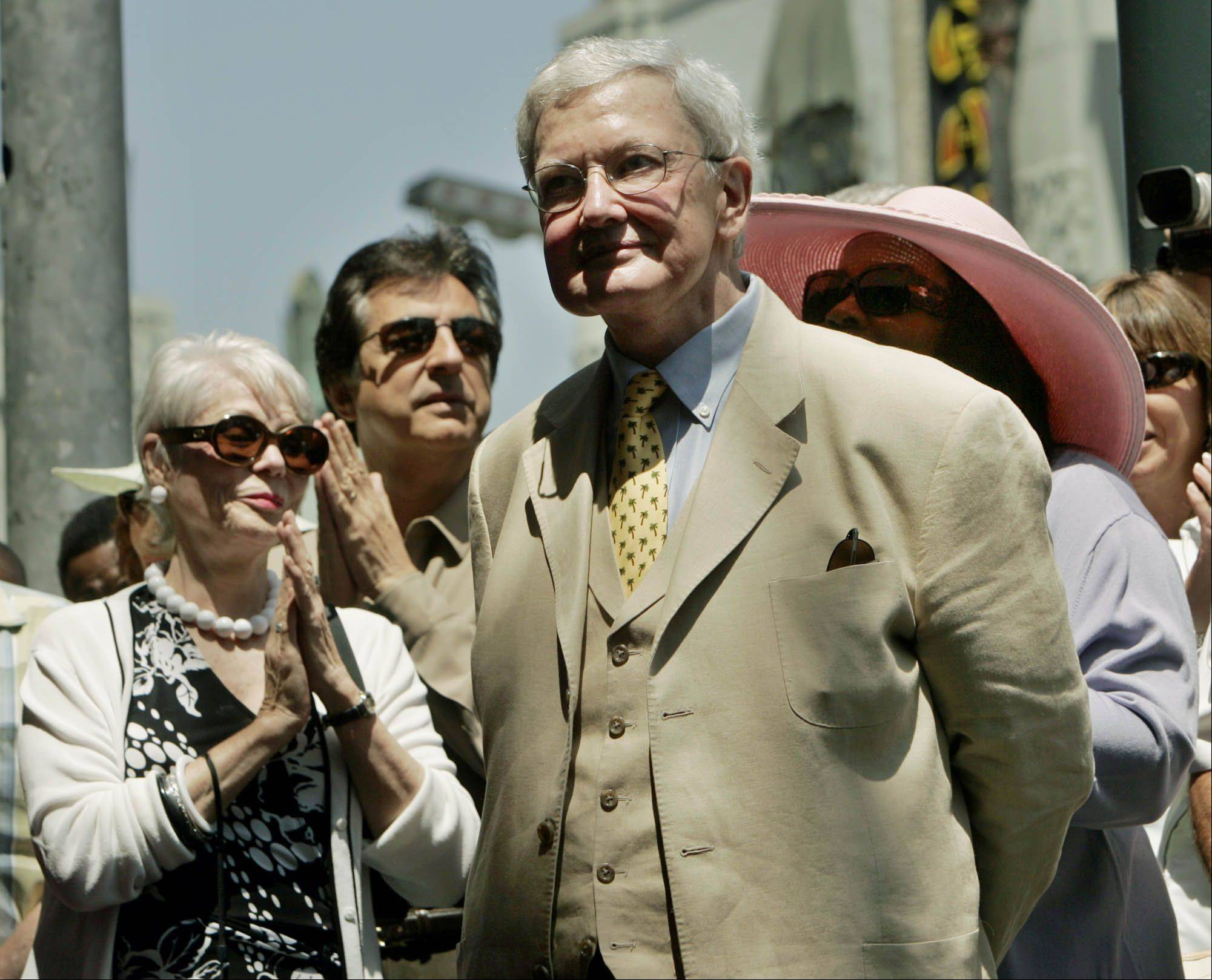 Film critic Roger Ebert, center, is applauded during a ceremony in his honor Thursday, June 23, 2005, in the Hollywood section of Los Angeles. Ebert was honored with the 2,288th star on the Hollywood Walk of Fame.