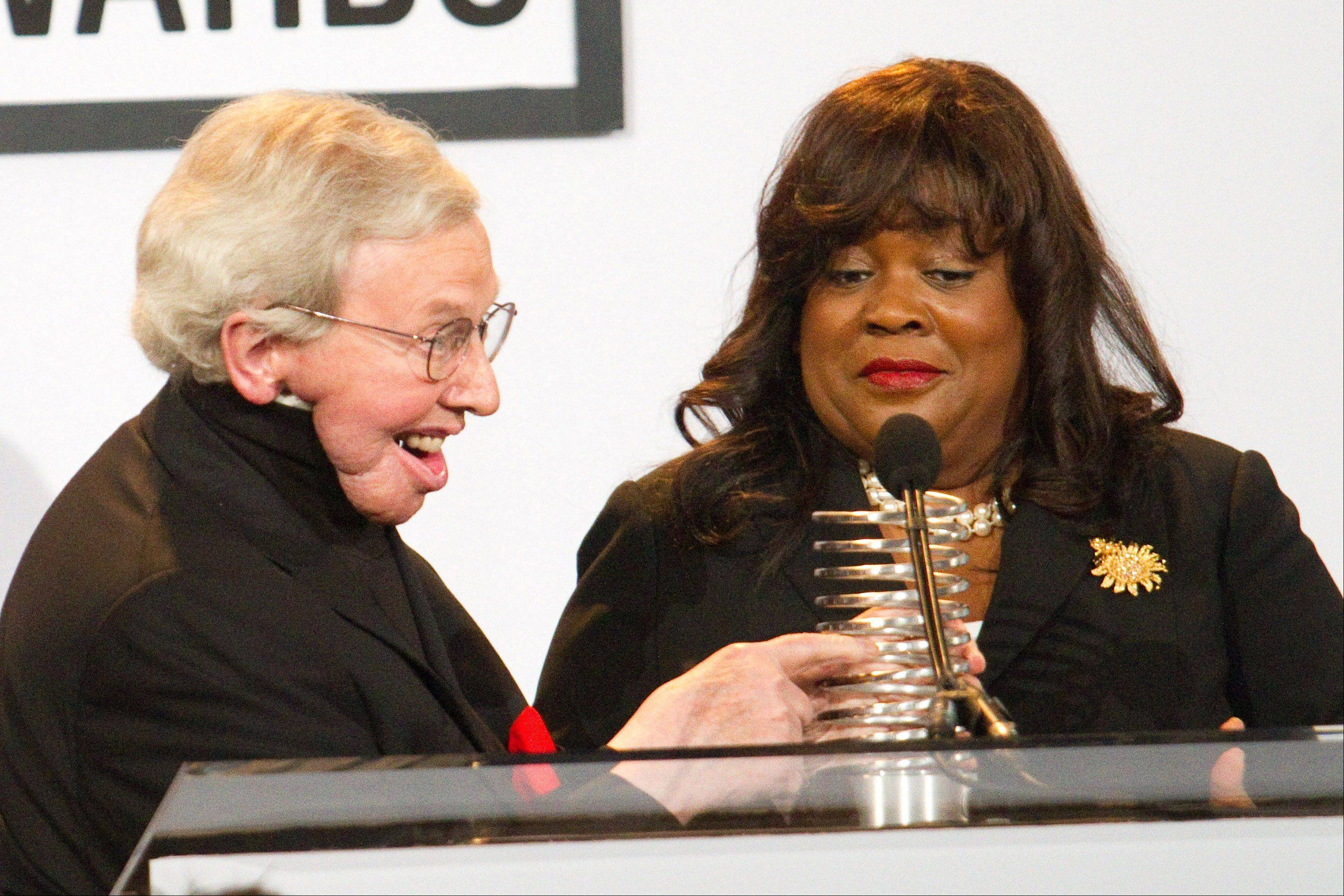 "Roger Ebert, alongside wife Chaz Hammelsmith, accepts the ""Person of the Year"" Award at the 14th Annual Webby Awards in New York, Monday, June 14, 2010."