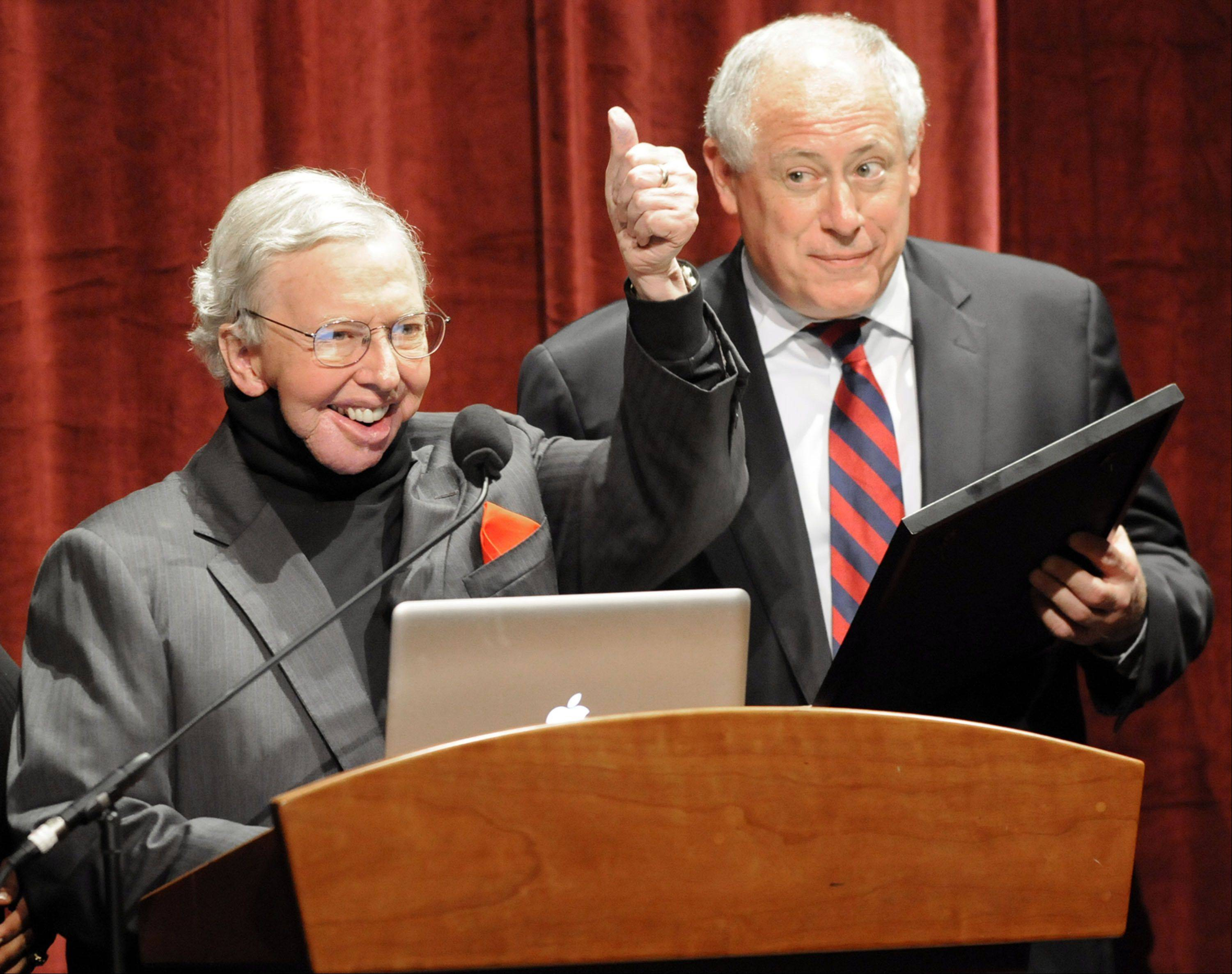 Film Critic Roger Ebert, left, gives a thumbs up to the audience as Illinois Governor Pat Quinn reads a proclamation declaring April 21, 2010 Roger Ebert Day in Illinois during the opening of the Twelfth Annual Roger Ebert's Film Festival at the Virginia Theatre in Champaign on Wednesday, April 21, 2010.