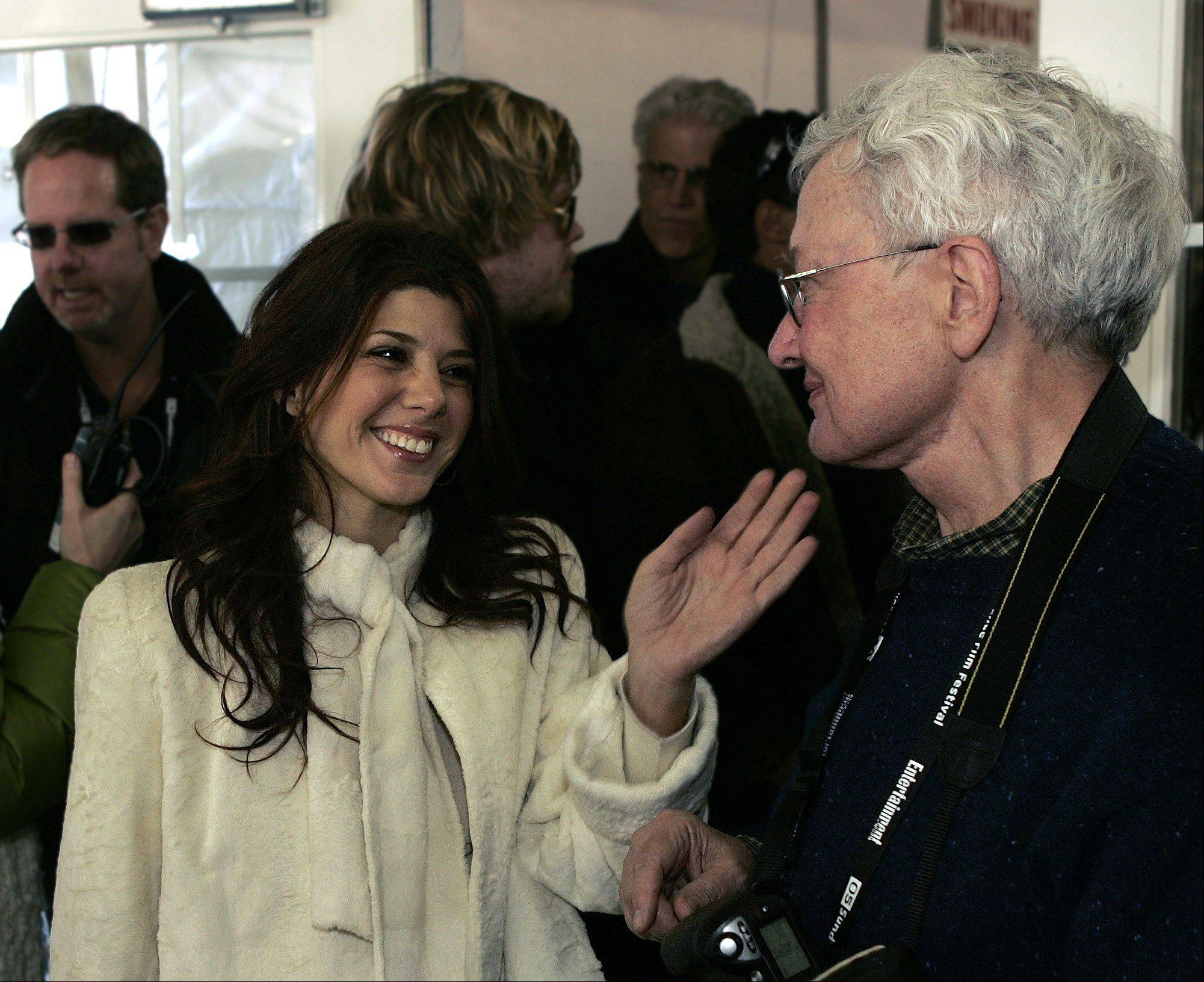 "Actress Marisa Tomei and film critic Roger Ebert chat at the premier of her film ""Marilyn Hotchkiss Ballroom Dancing & Charm School "" Monday, Jan. 24, 2005, in Park City, Utah, during the Sundance Film Festival."