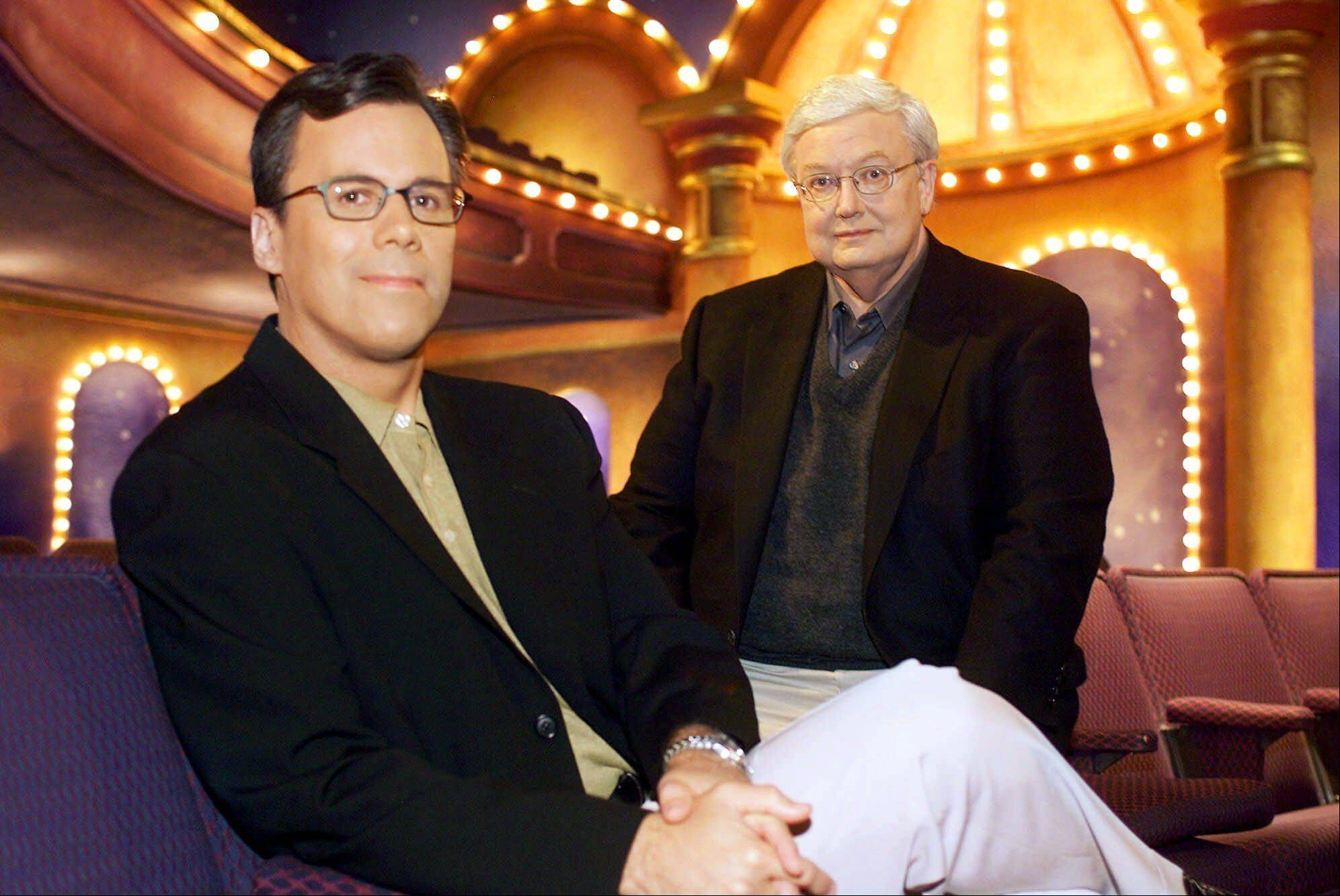 "Chicago Sun-Times columnist Richard Roeper, left, sits with Sun-Times film critic Roger Ebert on the set of the newly named ""Ebert & Roeper and The Movies"" Wednesday, July 12, 2000, in Chicago. It was announced Wednesday that Roeper would permanently replace Gene Siskel, who died last year, in the chair opposite Ebert on the long-running film criticism television show."
