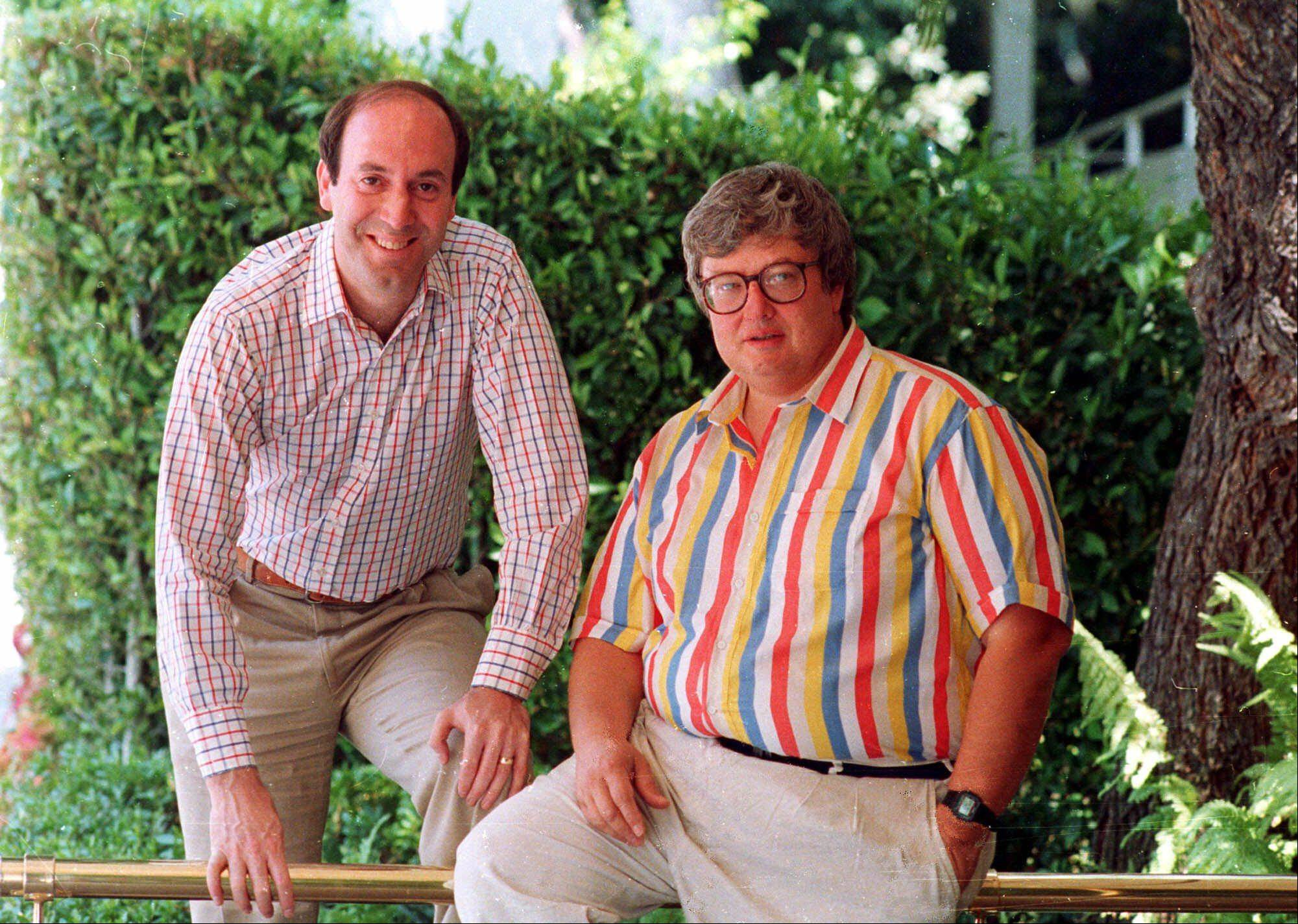 "Roger Ebert, right, poses with Gene Siskel in Los Angeles in this 1986 photo. The rivalry between the two Chicago film critics who combine their talents on the movie review show ""Siskel & Ebert & The Movies"" has helped make them media stars."