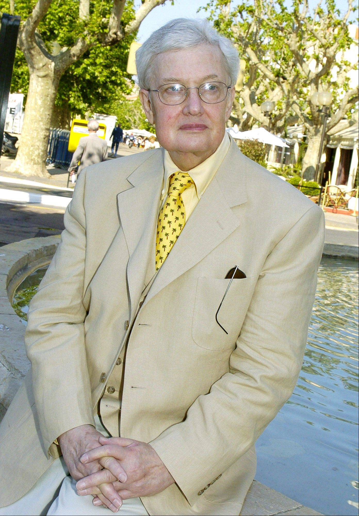"This May 17, 2004 file photo shows American film critc Roger Ebert, poses at the 57th International Film Festival in Cannes, southern France. The Sundance Institute announced Thursday, Sept. 20, 2012 that Ebert will be the recipient of the Vanguard Leadership Award in recognition of his advocacy of independent film. The award will be presented at the third annual ""Celebrate Sundance Institute"" benefit on June 5, in Los Angeles."