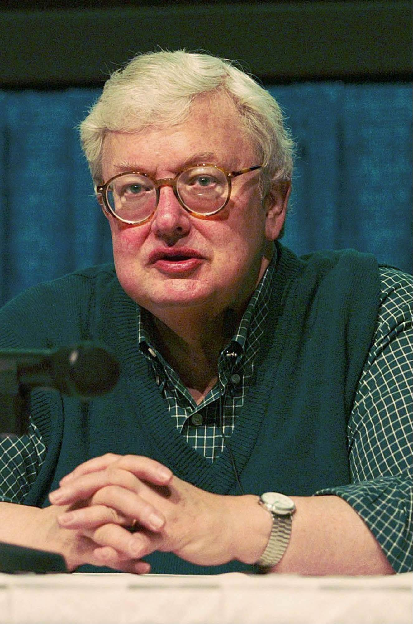 Film critic Roger Ebert is seen in this 1994 file photo. Ebert, in town for his annual Overlooked Film Festival, slipped on a newly waxed floor and suffered two hairline fractures in his left shoulder Saturday, April 27, 2002, in the student union at the University of Illinois.