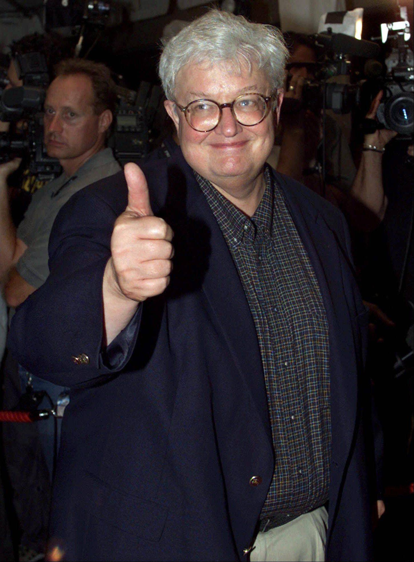 "Movie critic Roger Ebert gives the thumbs up as he arrives on the red carpet for the premiere of the film ""Training Day"" at the Toronto International Film Festival in Toronto, Canada, in this Sept. 7, 2001. Ebert will undergo surgery to remove a cancerous growth on his thyroid gland. The operation for Ebert, a Chicago Sun-Times movie reviewer, is scheduled for Friday, the paper reported Thursday, Feb. 21, 2002."